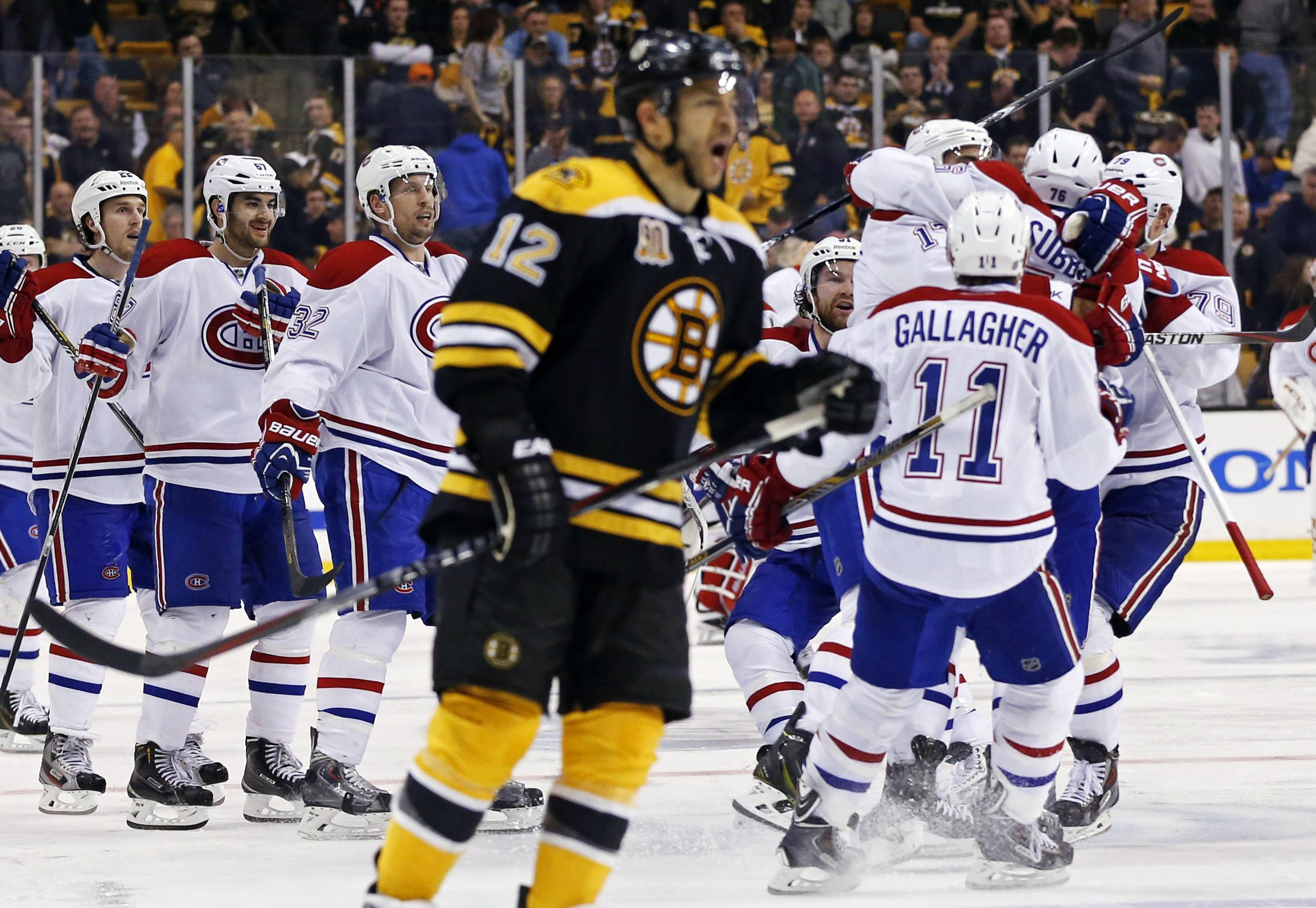 Montreal Canadiens teammates jump on P.K. Subban, right, after his game-winning goal in the second overtime period as Boston Bruins right wing Jarome Iginla (12) skates away in Game 1 of an NHL hockey second-round playoff series in Boston, Thursday, May 1, 2014.