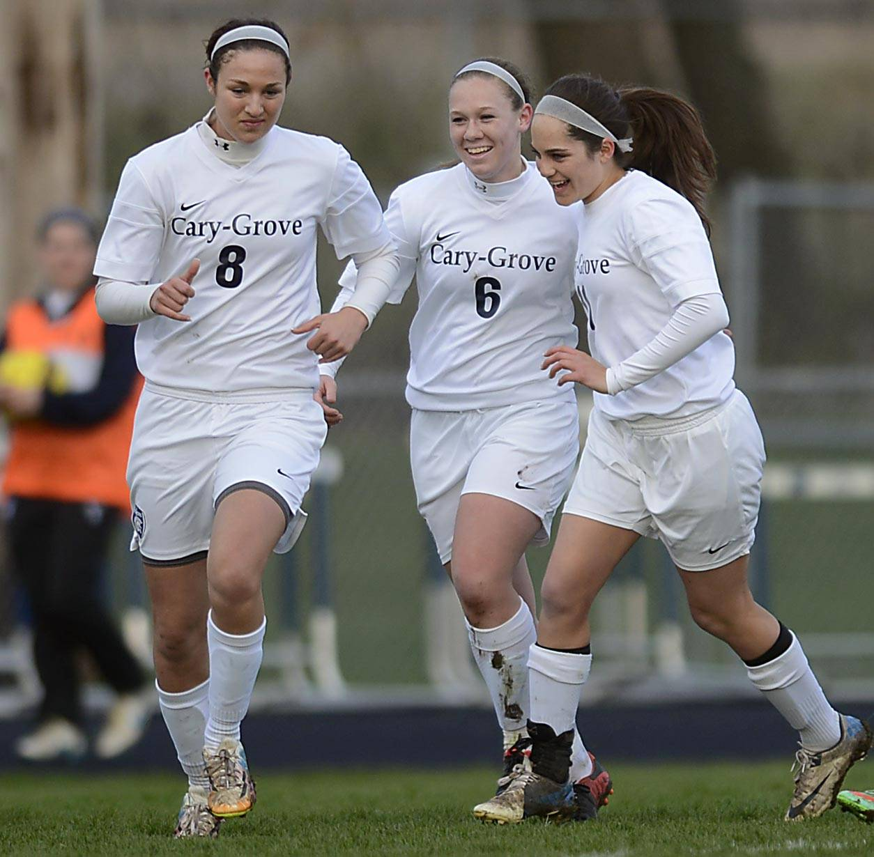 Cary-Grove's Katie Conner is flanked by teammates Abby Glaysher and JJ Baily, right, after her first-half goal against Huntley Thursday in Cary.