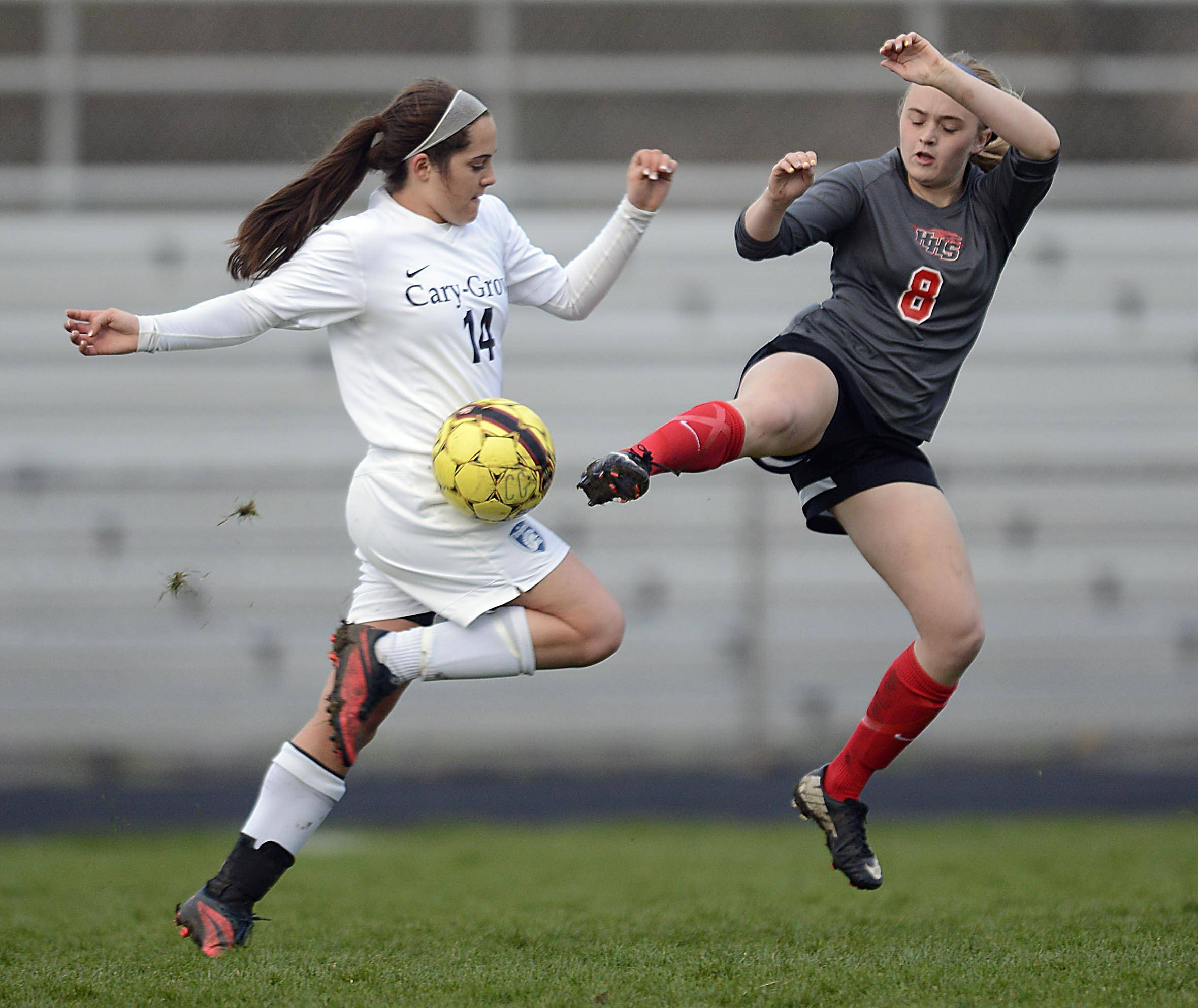 Cary-Grove's Ellie Baily and Huntley's Alyssa Kaufman fight for a loose ball Thursday in Cary.