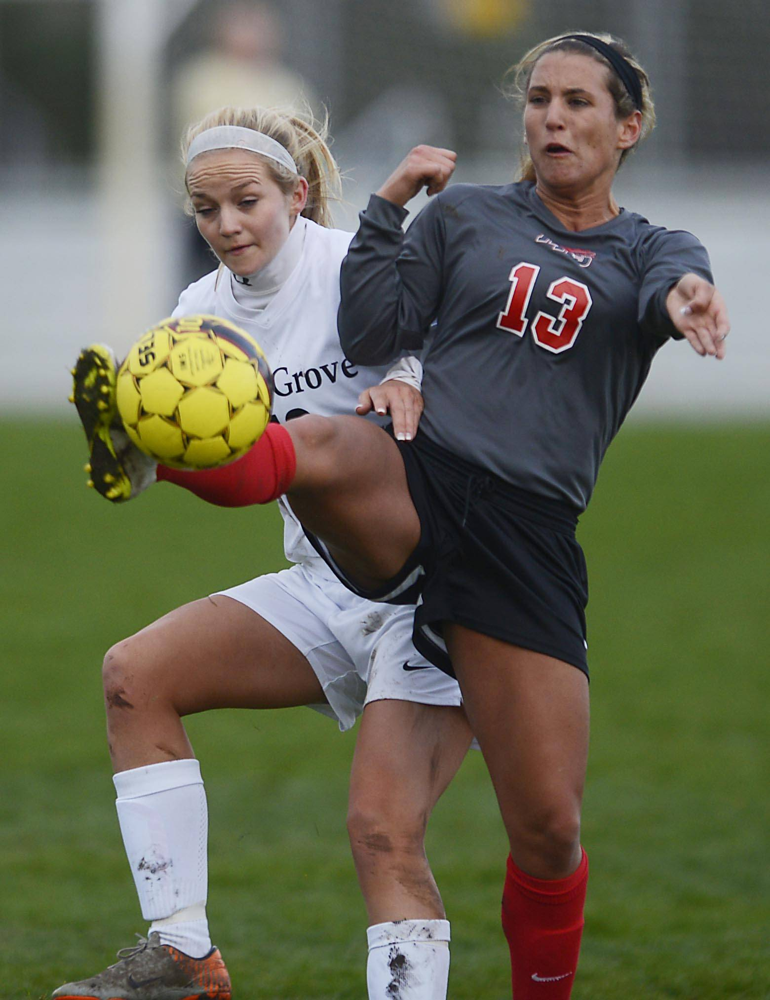 Huntley's Jenna Hermansen gets a foot on the ball in front of Cary-Grove's Emma Baker Thursday in Cary.