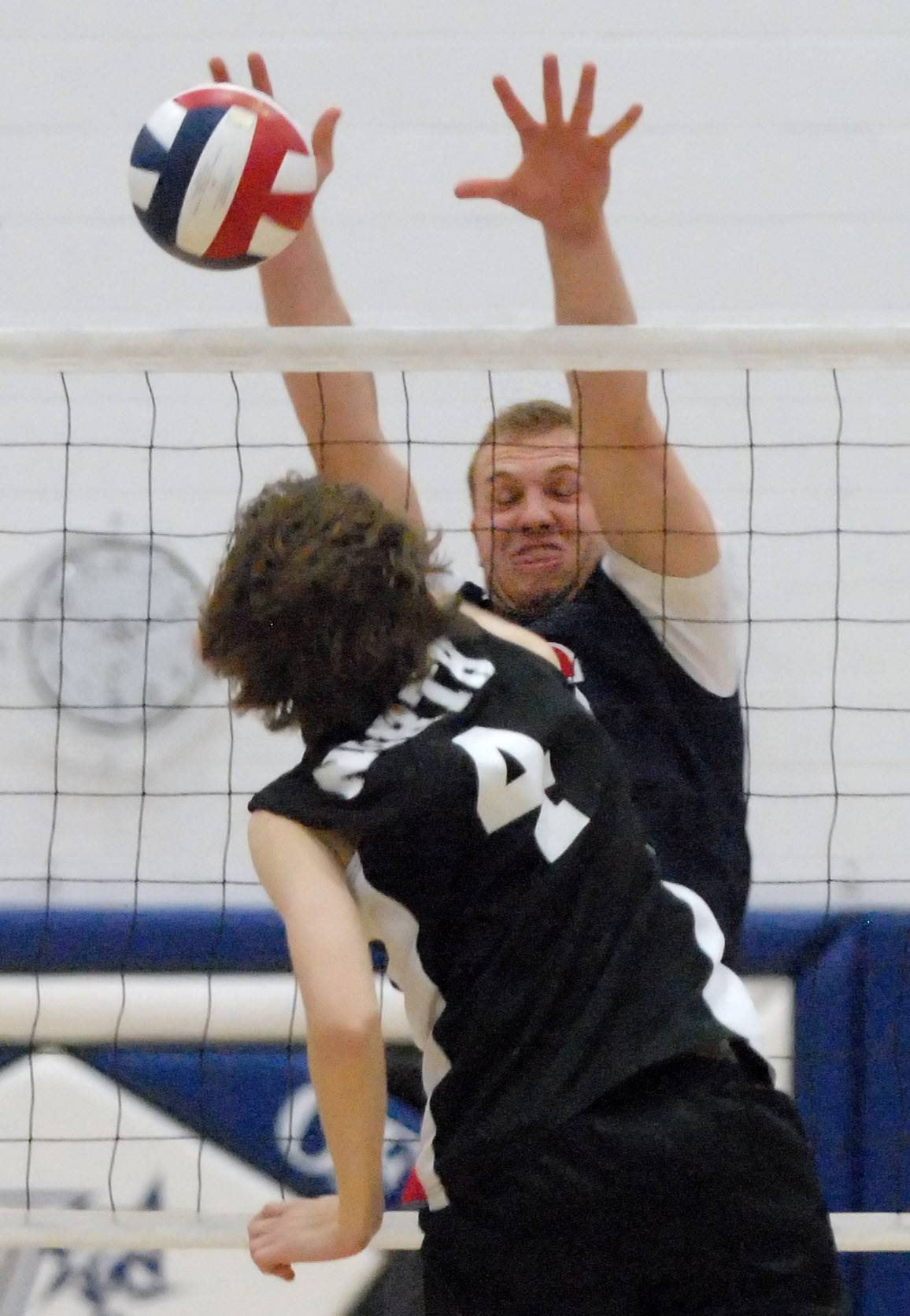 South Elgin's Nate Marotta blocks a spike by St. Charles North's Drew Lanz in the second match on Thursday, May 1.