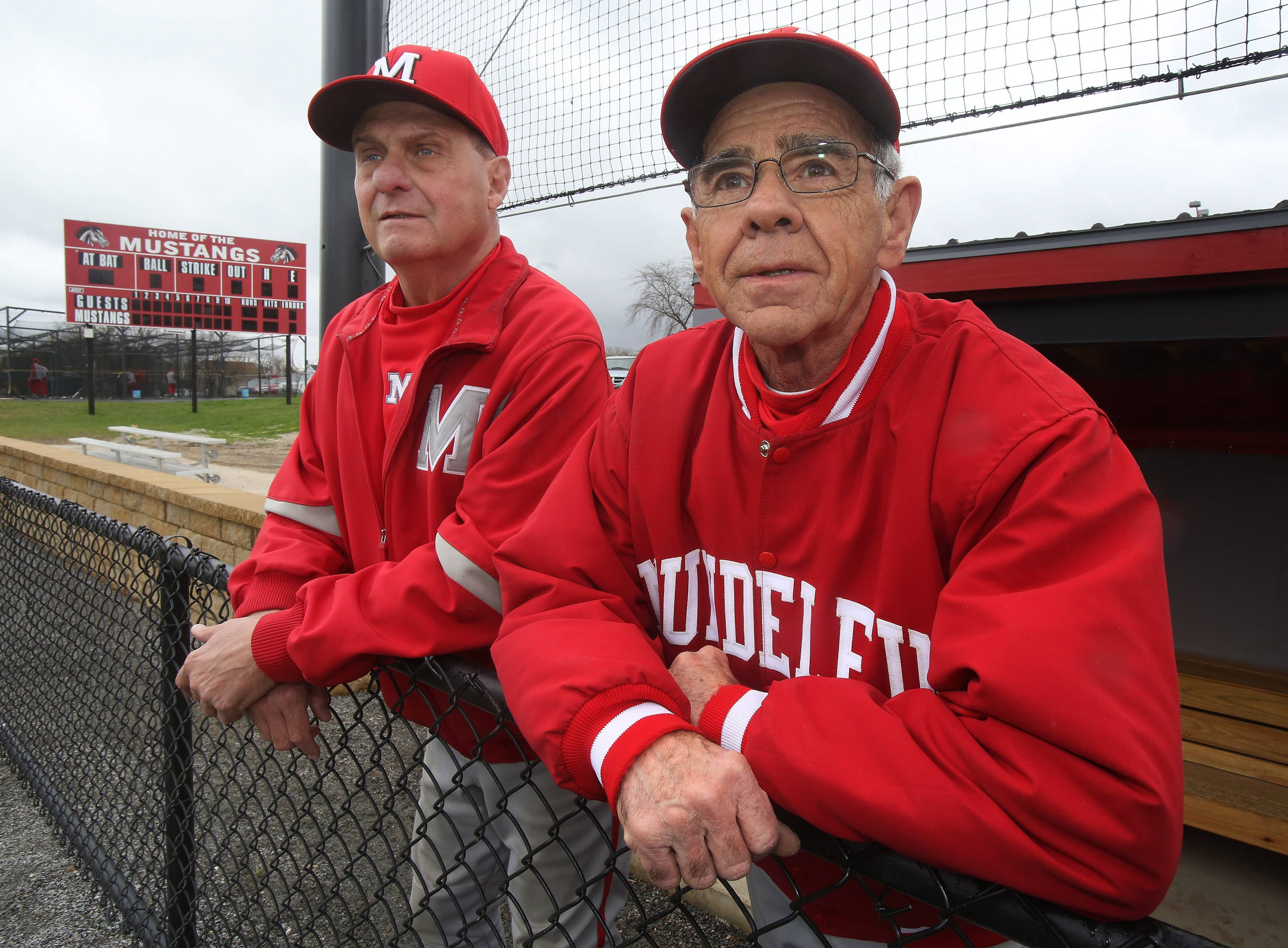 Mundelein assistant baseball coaches Fred Picket, left, and Neil McLoughlin have coached together for more than 45 years. Picket is retiring this year after 45 years and McLoughlin has coached more than 50 years at the high school.