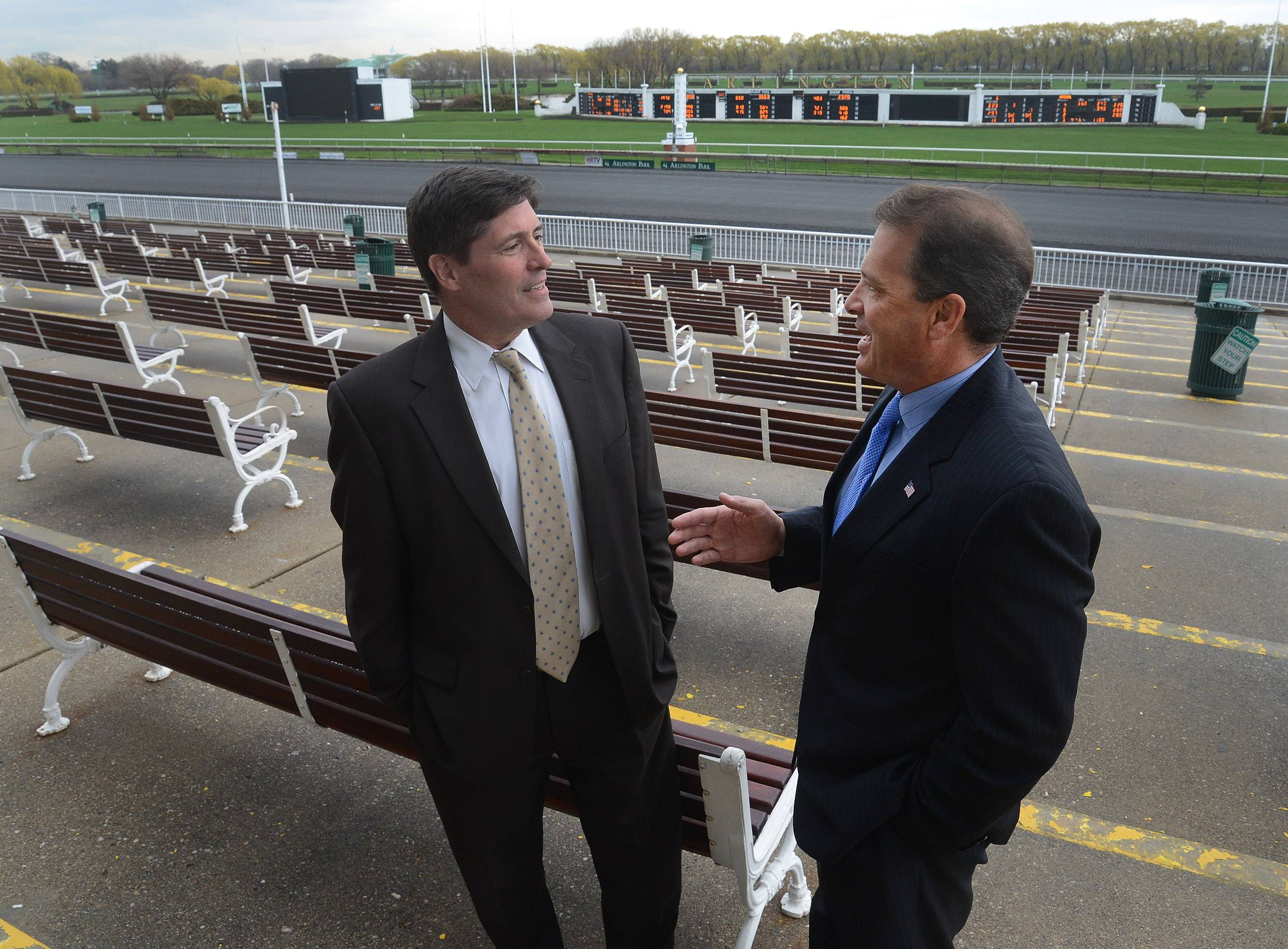 Racing secretary Chris Polzin, left, and track president Tony Petrillo expect to have more than 2,000 horses stabled at Arlington International this season, which would be about 300 more than last year. Arlington opens its season today.