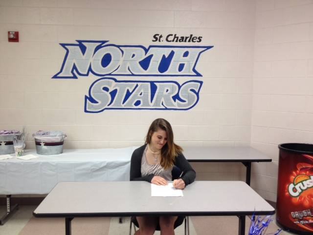 Carly signs a Letter of Intent for UIS today with the support of her parent, Andrea and Brian Hudon, Coach Smith and the girls varsity North Star golf team!