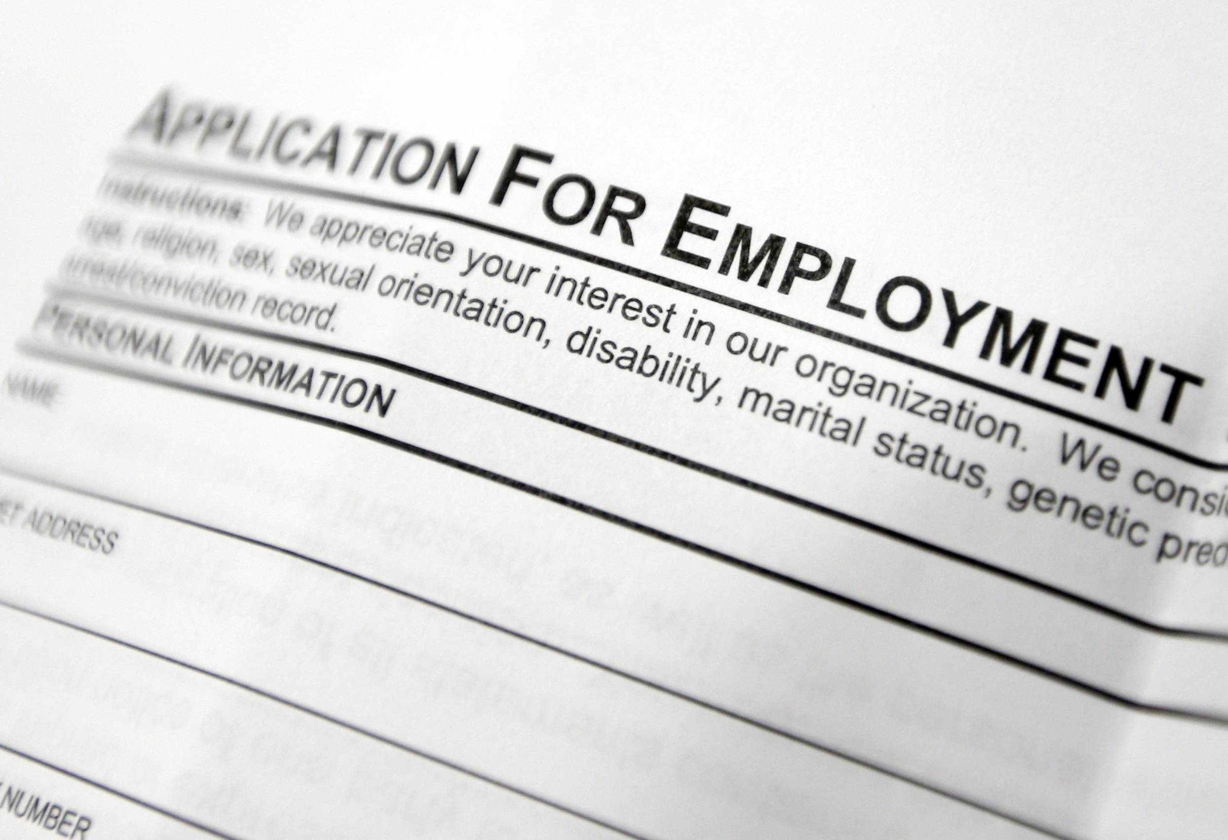 An employment application on a table during a job fair at Columbia-Greene Community College in Hudson, N.Y.