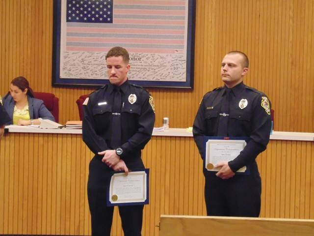 Hanover Park officials honored police officers Tim McNulty and Tim Allen for reviving a 29-year-old man overdosing on heroin.