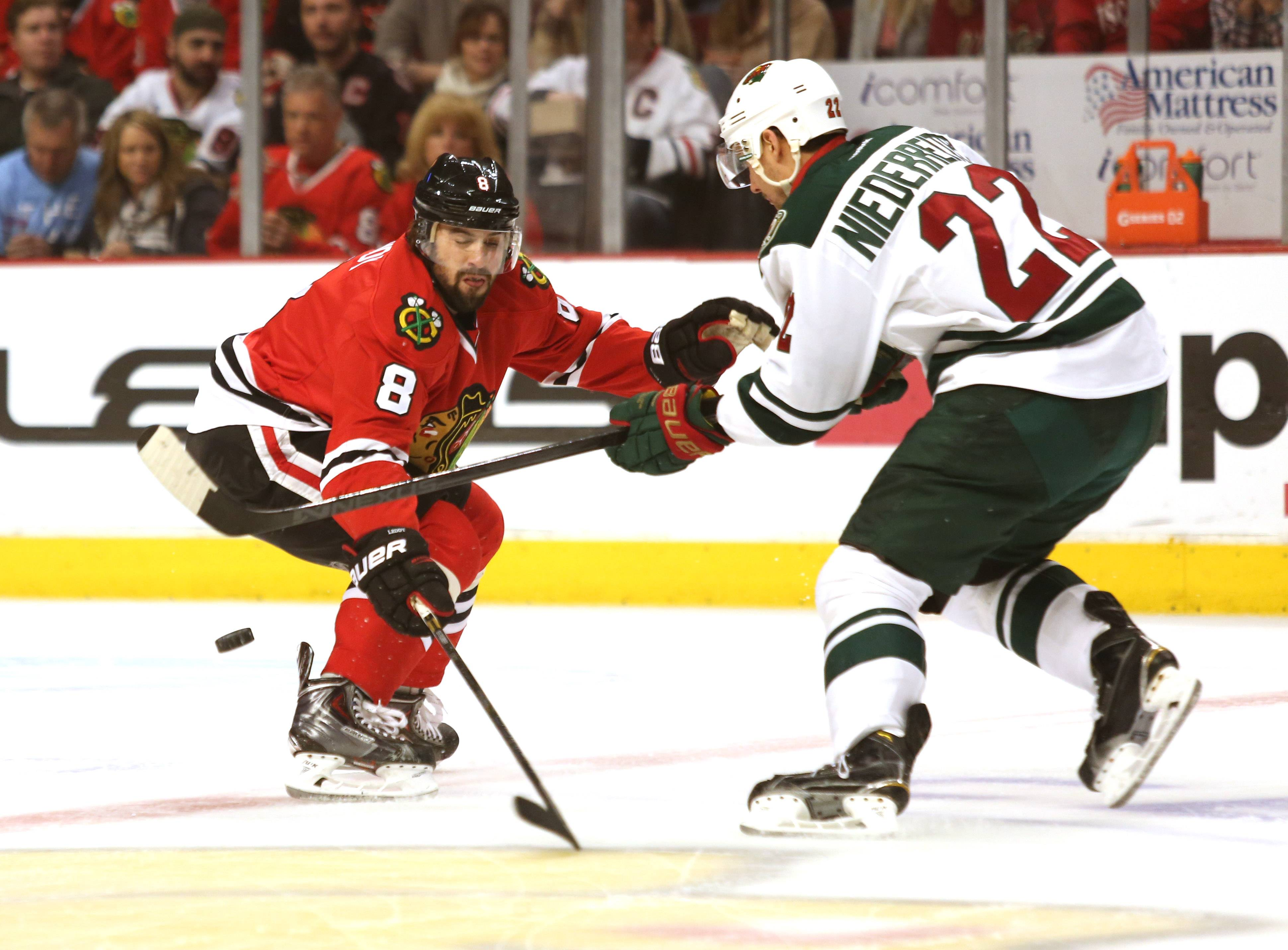 Blackhawks defenseman Nick Leddy pressures the Wild's Nino Niederreiter during the first period Friday in Game 1 of their second-round playoff series at the United Center.