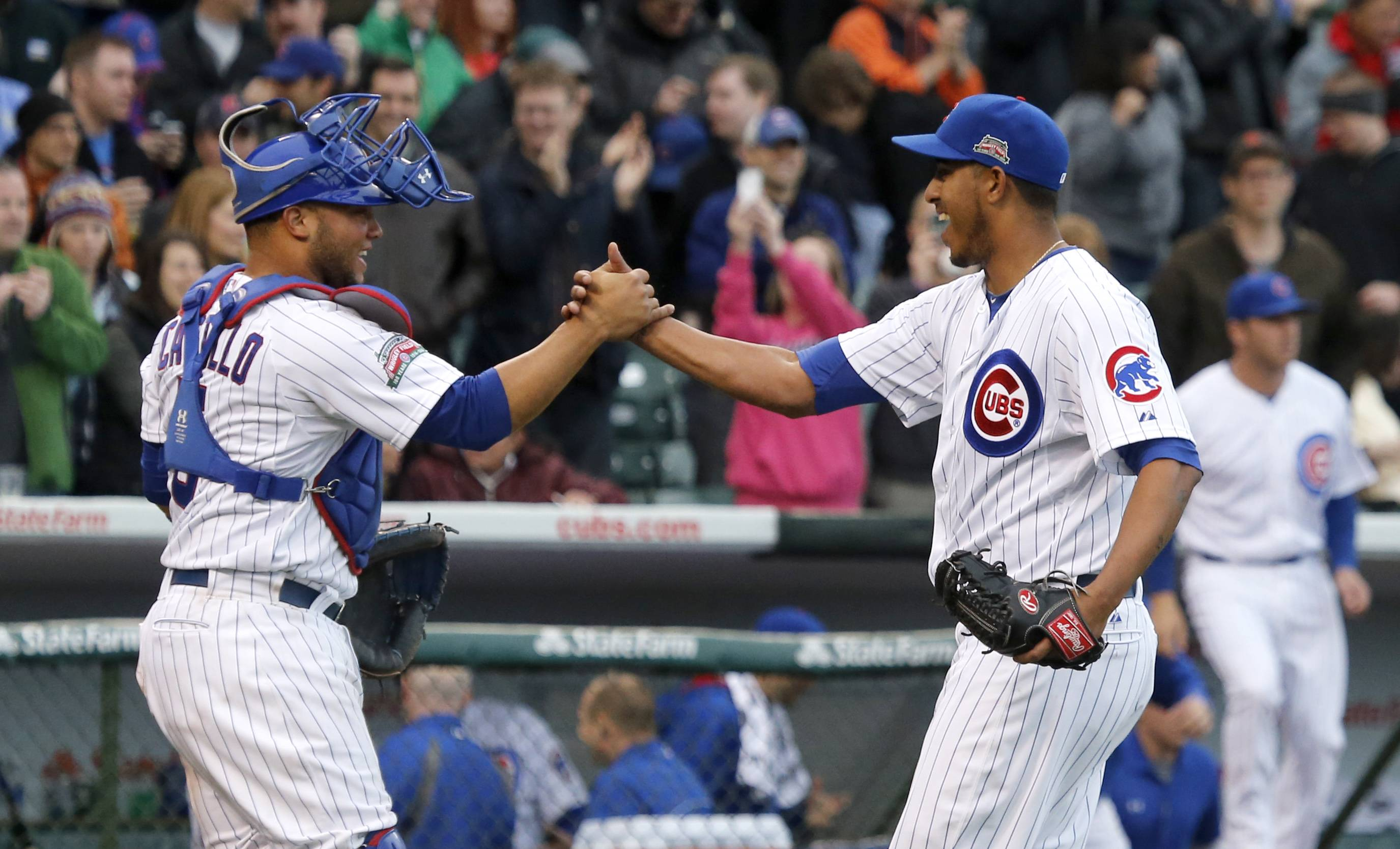 Chicago Cubs relief pitcher Hector Rondon, right, celebrates with catcher Welington Castillo, after their 6-5 win over the St. Louis Cardinals in a baseball game Friday, May 2, 2014, in Chicago. (AP Photo/Charles Rex Arbogast)