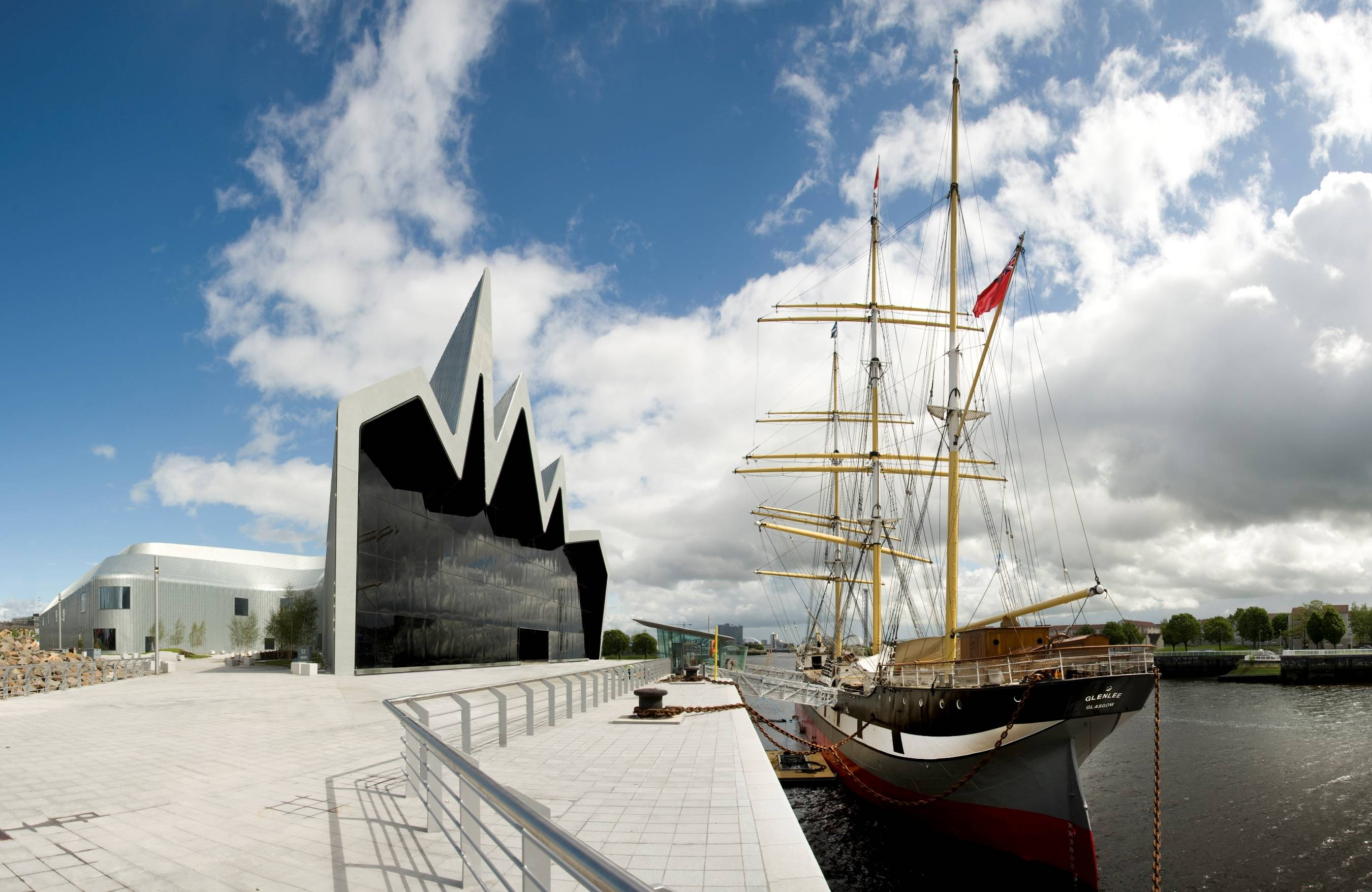 Exhibits at the Riverside Museum on the banks of the Clyde River in Glasgow include a sailing ship permanently moored outside the museum. The museum, which is free to visit, was designed by renowned architect Zaha Hadid.