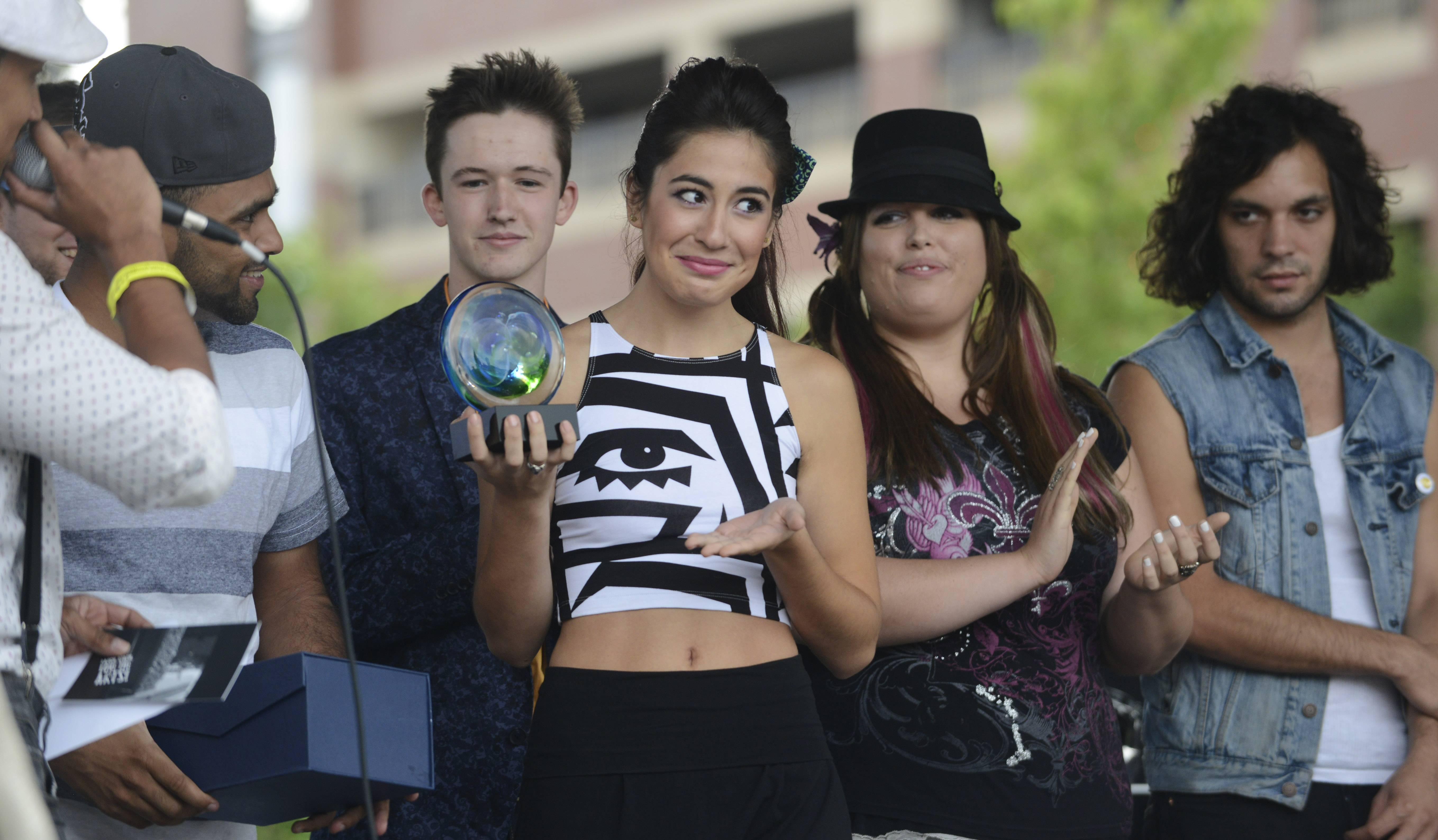 Gabriela Francesca holds her trophy after being announced the winner of the 2013 edition of Suburban Chicago's Got Talent at the Taste of Arlington Heights.