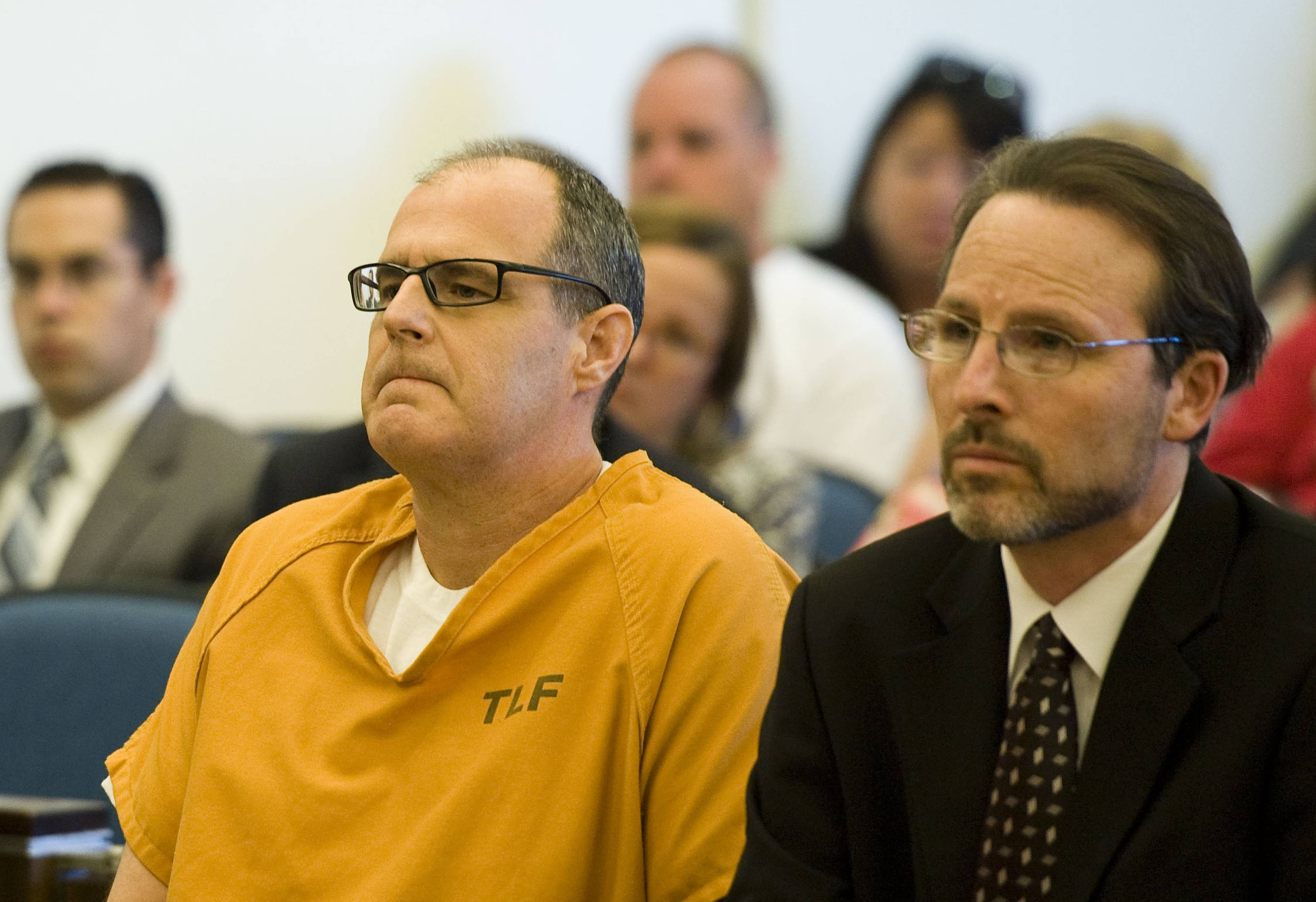 Scott Dekraai sits Friday with his public defender Scott Sanders in Orange County Superior Court in Santa Ana, Calif.