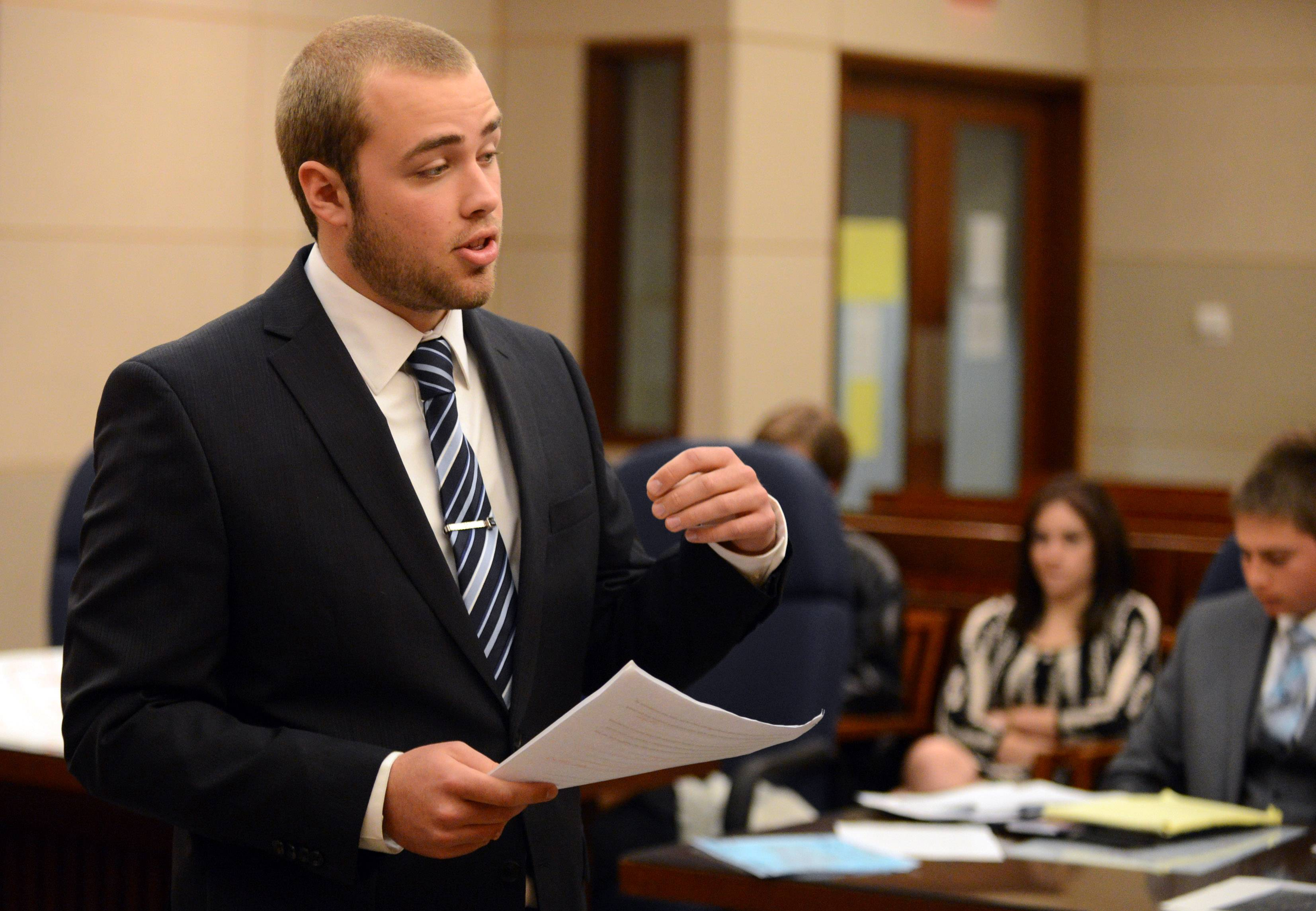Bartlett's Andrew Eckelberry offers the prosecution's opening remarks during the Law Day Mock Trial Program Friday at the Kane County Courthouse in St. Charles.