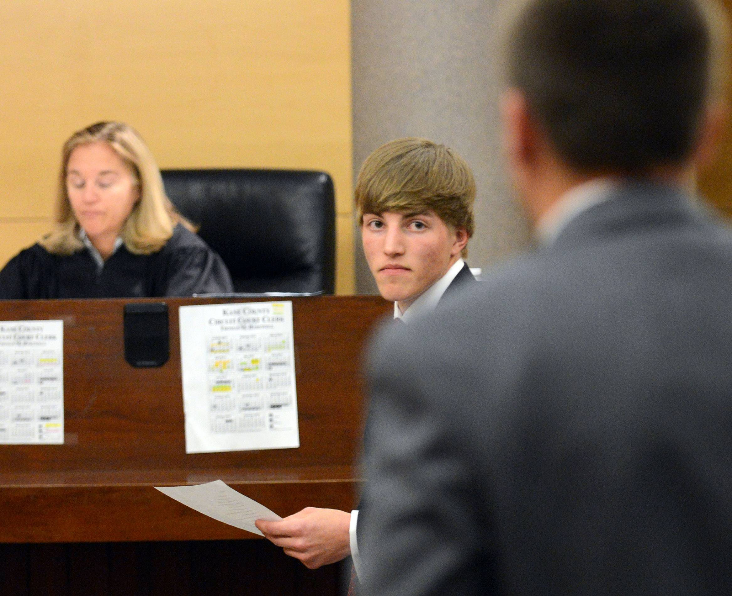 Batavia's Eric Phillips looks back as the prosecution objects to a question he posed to a witness during the Law Day Mock Trial Program Friday at the Kane County Courthouse in St. Charles.