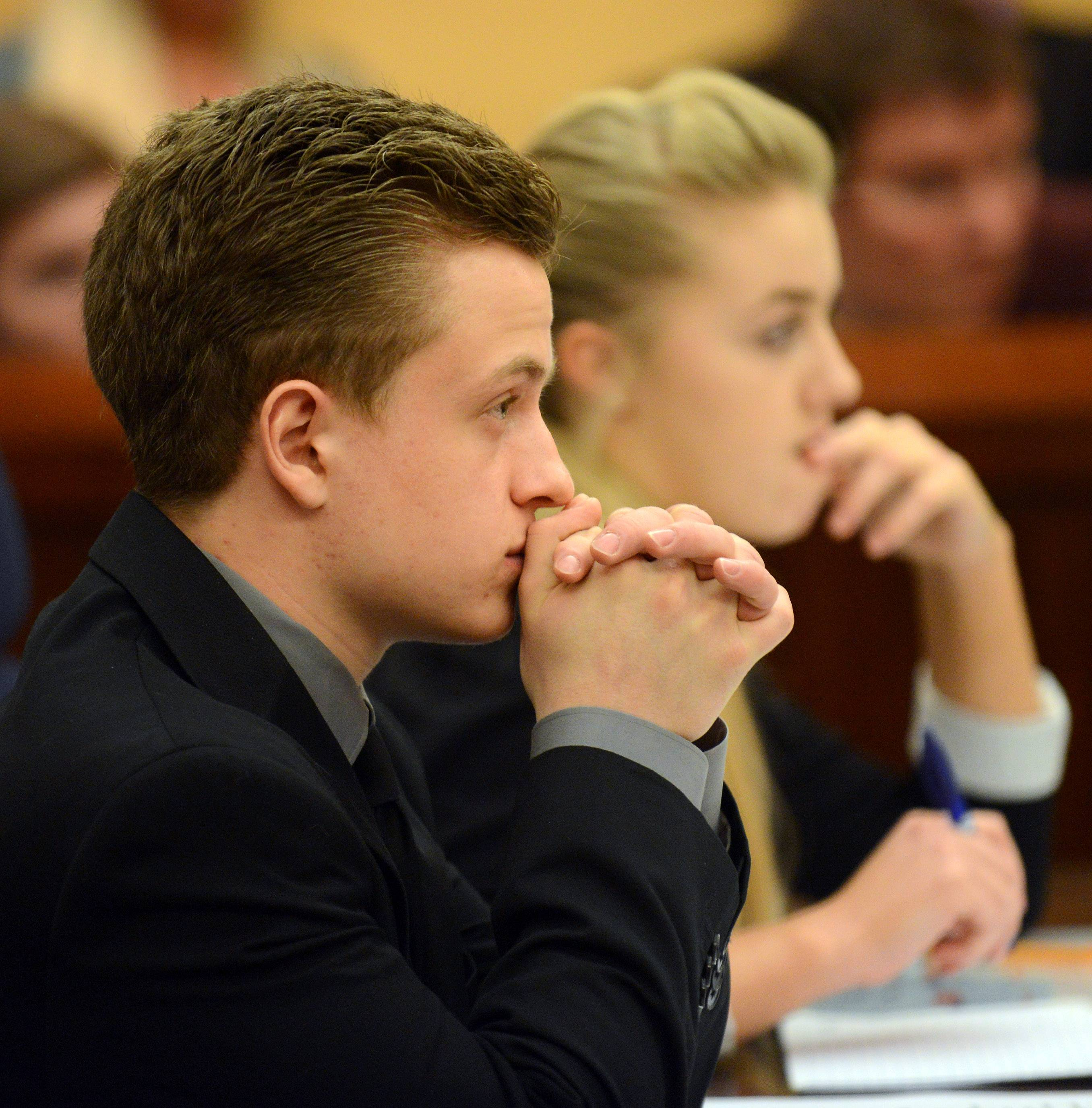 """Prosecutors"" Jeremy Abbate and Fallon Sebestin of Bartlett watch testimony as students from six high schools participate in mock trials Friday at the Kane County Courthouse in St. Charles."