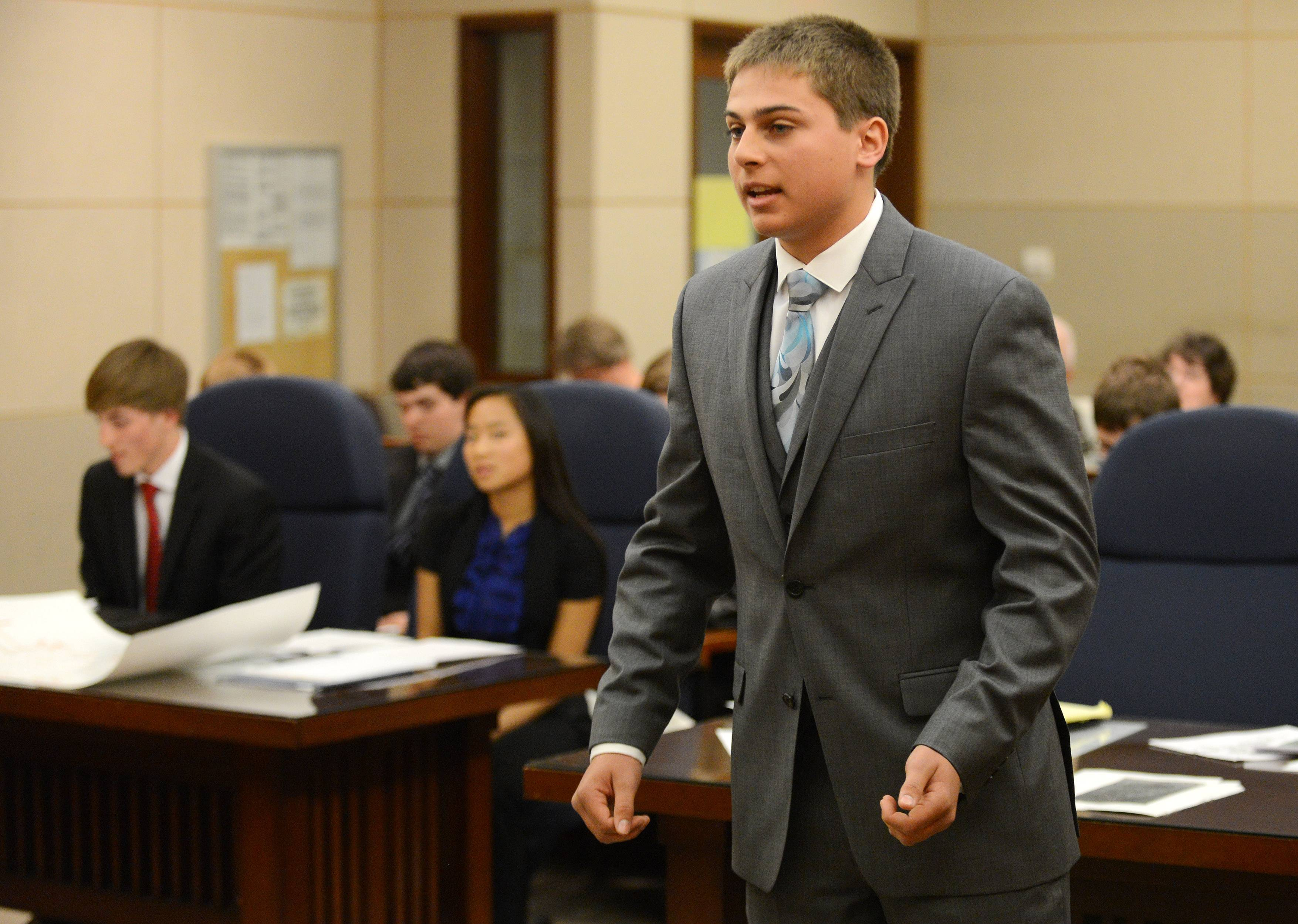 """Prosecutor"" Sean McCauley of Bartlett questions a witness as students from six high schools participate in mock trials Friday at the Kane County Courthouse in St. Charles."