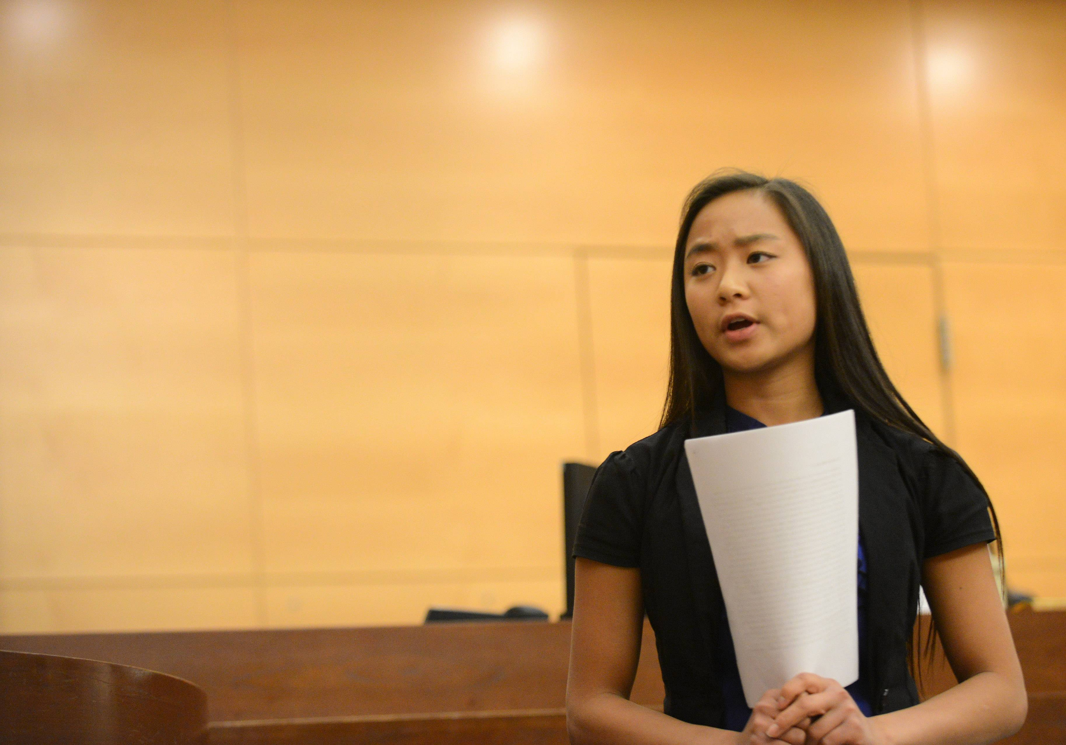 Batavia's Lia Kruse questions a witness as students from six high schools participate in mock trials Friday at the Kane County Courthouse in St. Charles.