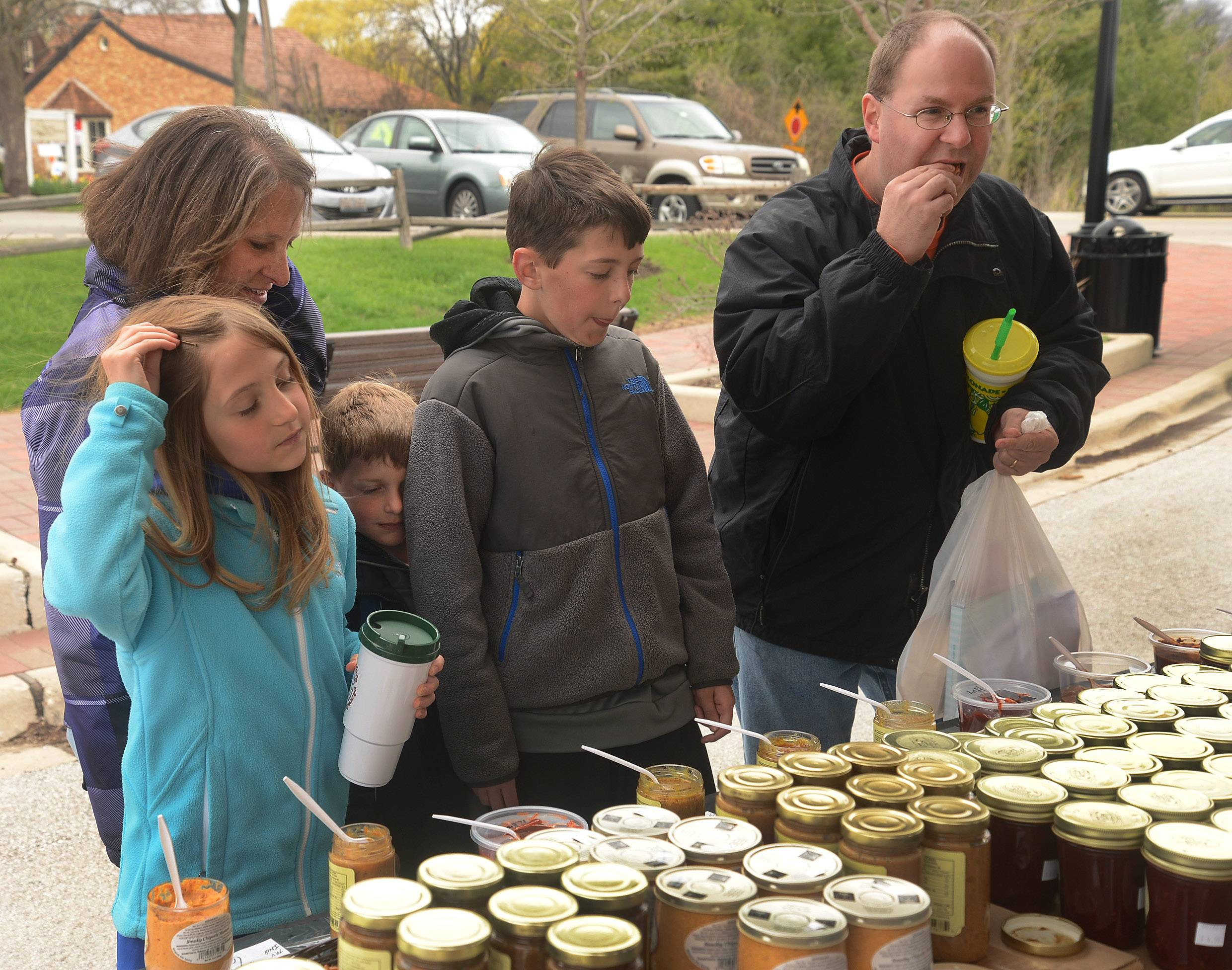 It isn't all chocolate. The Jaszczurowski family of Bartlett -- from left, Katie, Beverly, Zack, Johnny and Mike -- sample some mustards and sauces from Chef Ivo's Galena Canning Co.