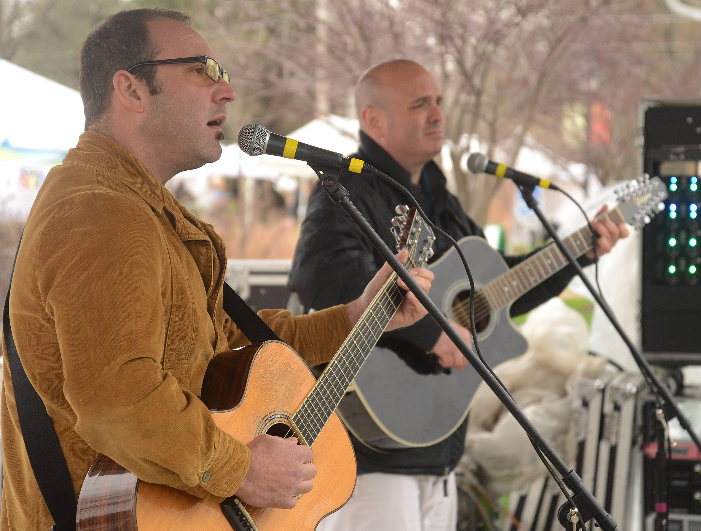 Wes John Cichosz, left, and Sean Cantorna of the Blend Acoustic Duo perform on one of three music stages.