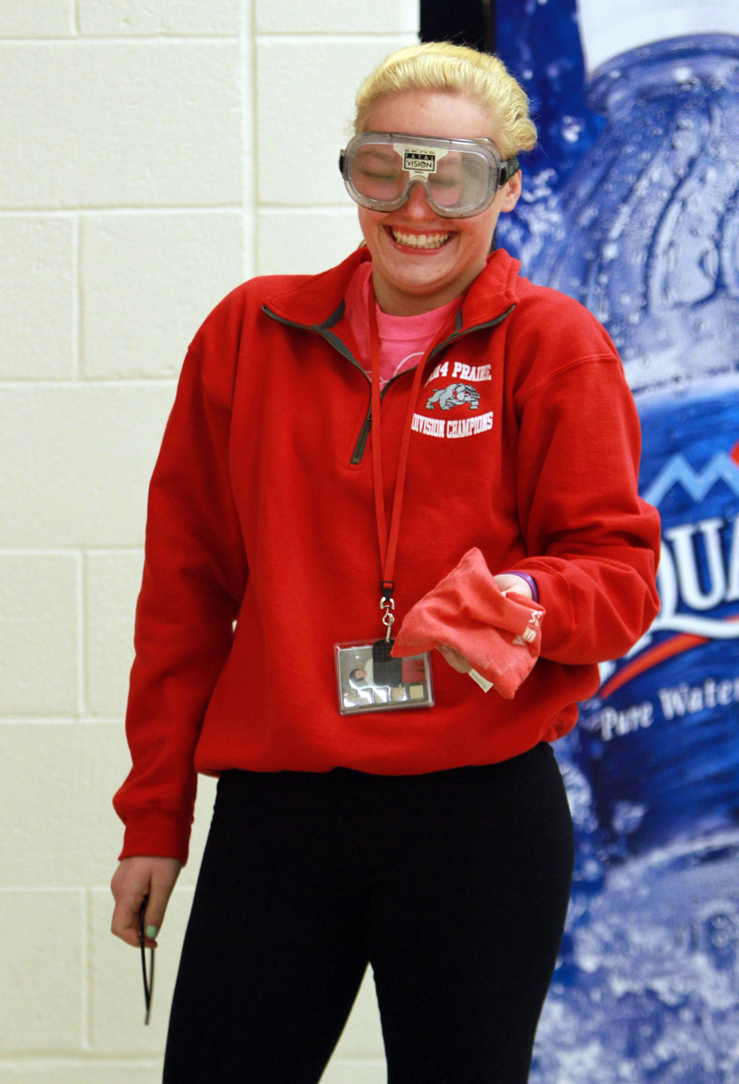 Grant High School sophomore Mikayla Briggs giggles as she tries to play baggo with goggles that simulate being intoxicated during a pre-prom event Friday at the Fox Lake school.