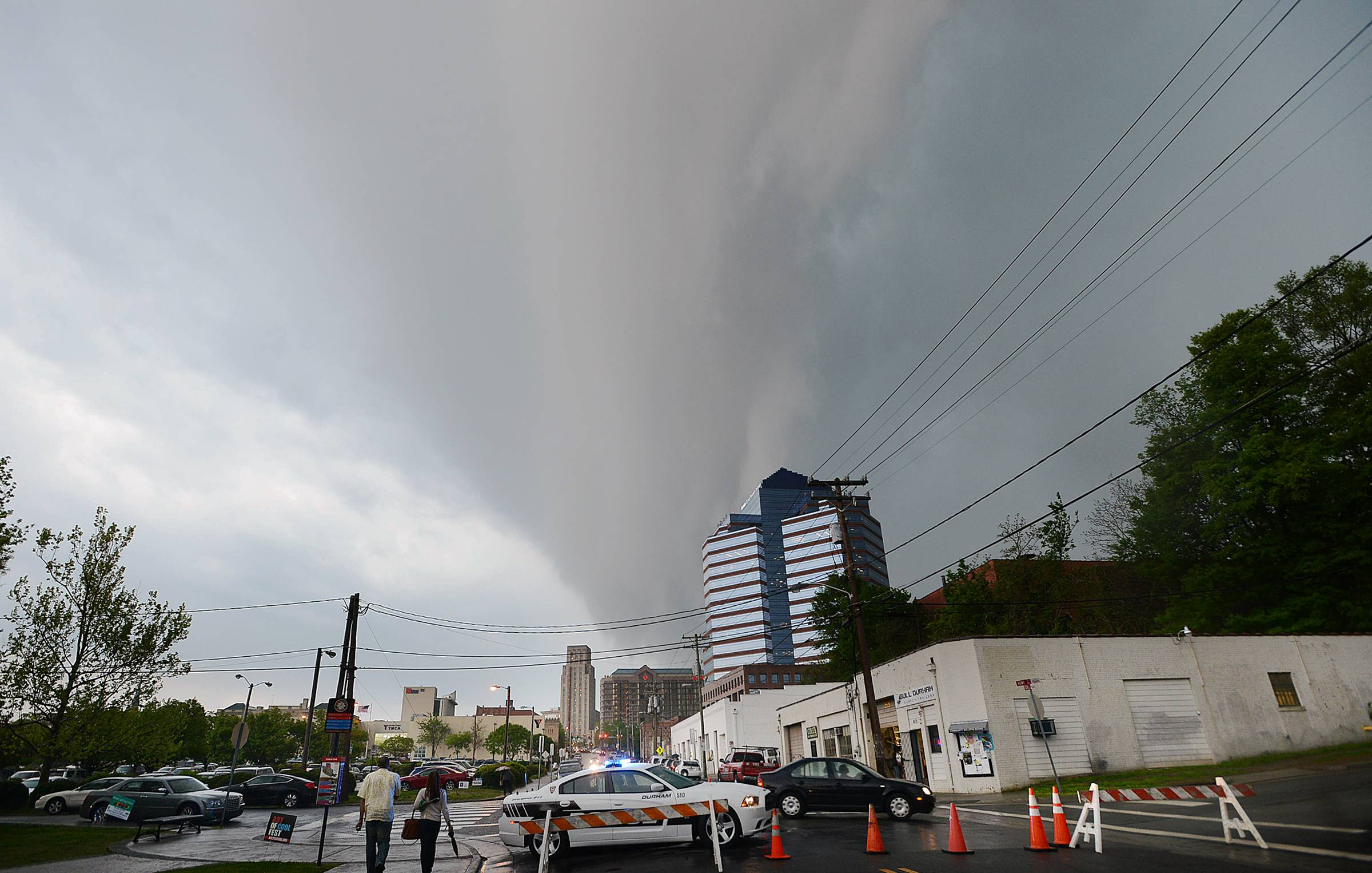 Menacing dark clouds brought rain, wind and lightning above downtown Durham North Carolina as cold and warm fronts clashed, making a dangerous weather situation.