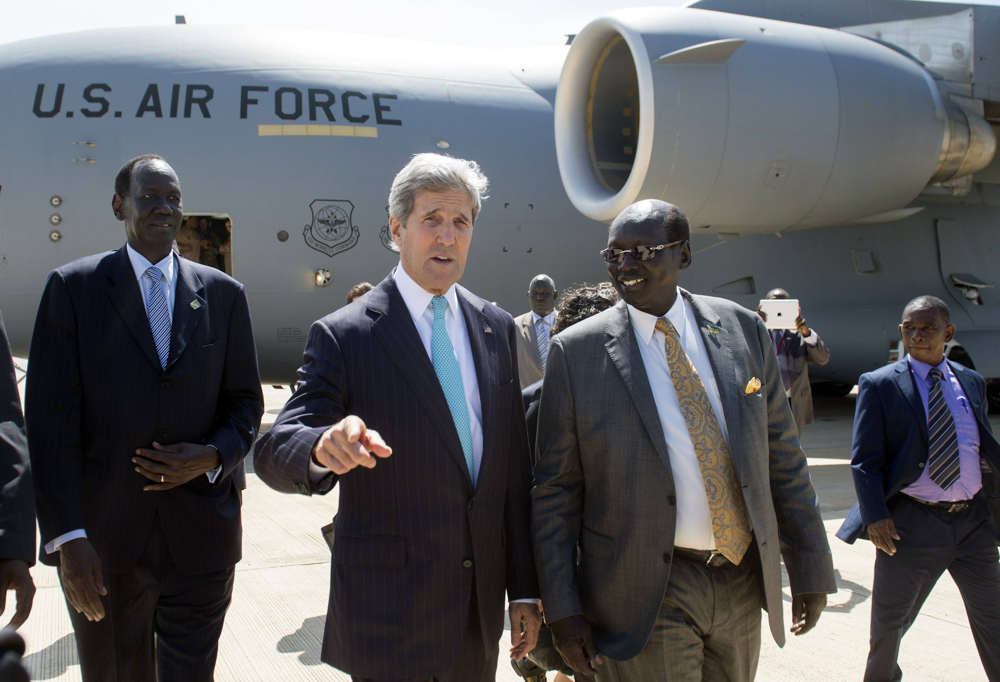 U.S. Secretary of State John Kerry, center, arrives aboard a U.S. military airplane at Juba International Airport in Juba, South Sudan, Friday, May 2, 2014. Kerry is urging South Sudan's warring government and rebel leaders to uphold a monthslong promise to embrace a cease-fire or risk the specter of genocide through continued ethnic killings.