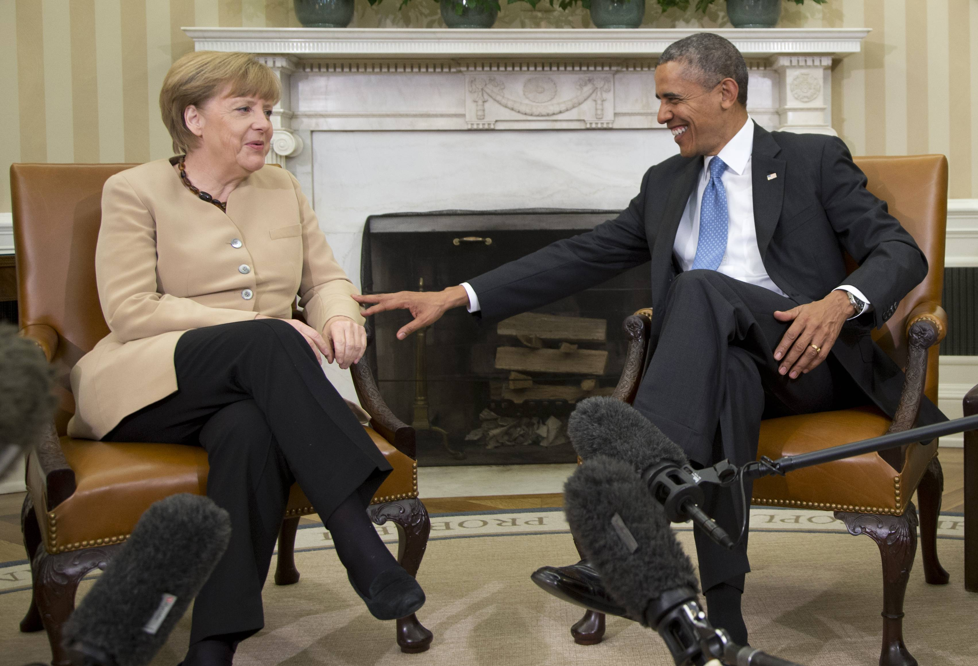 President Barack Obama meets with German Chancellor Angela Merkel in the Oval Office of the White House in Washington, Friday, May 2, 2014.