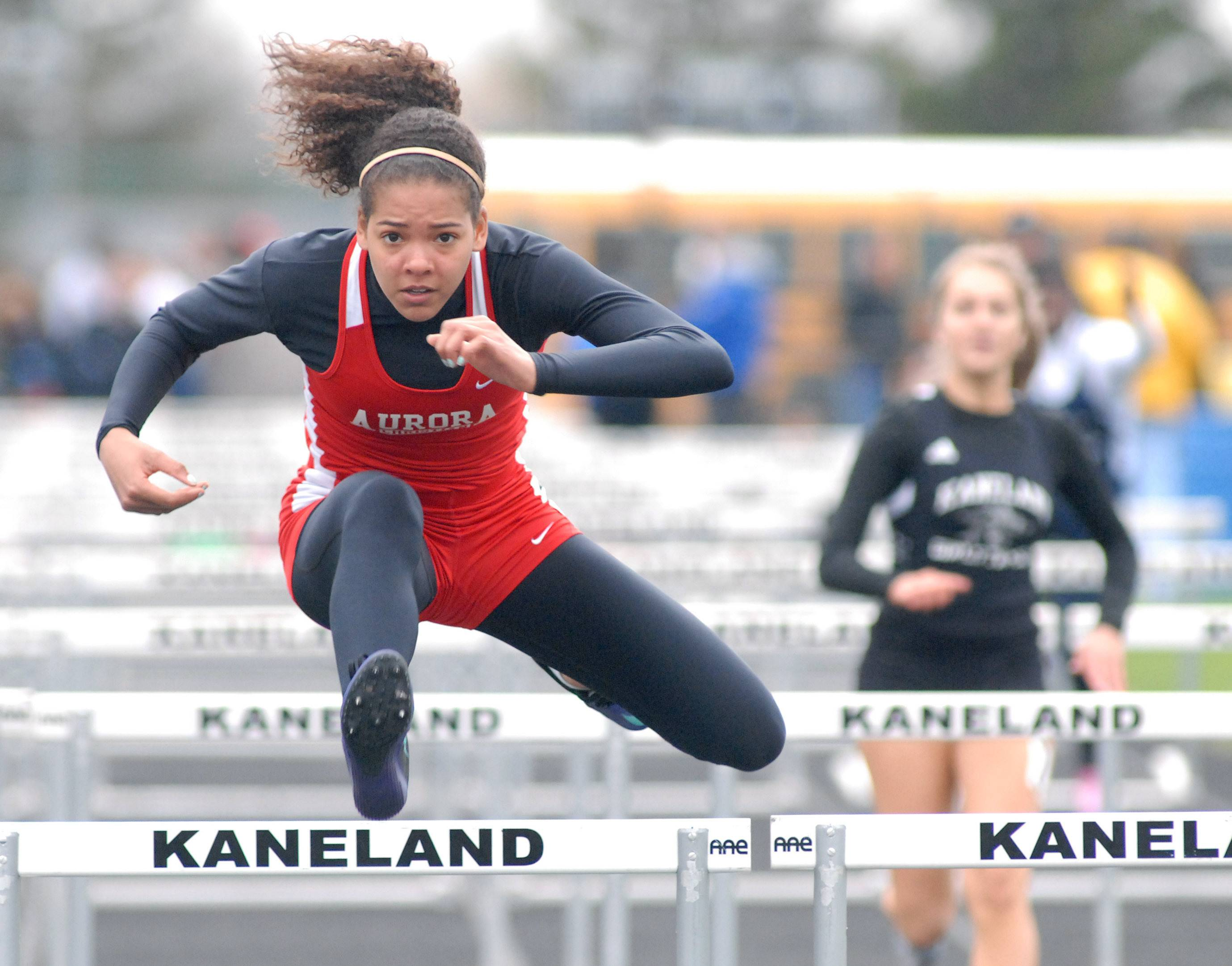 Aurora Christian's Peyton Wade in the prelims of the 100-yard hurdles at Kaneland High School in Maple Park on Friday, May 2.
