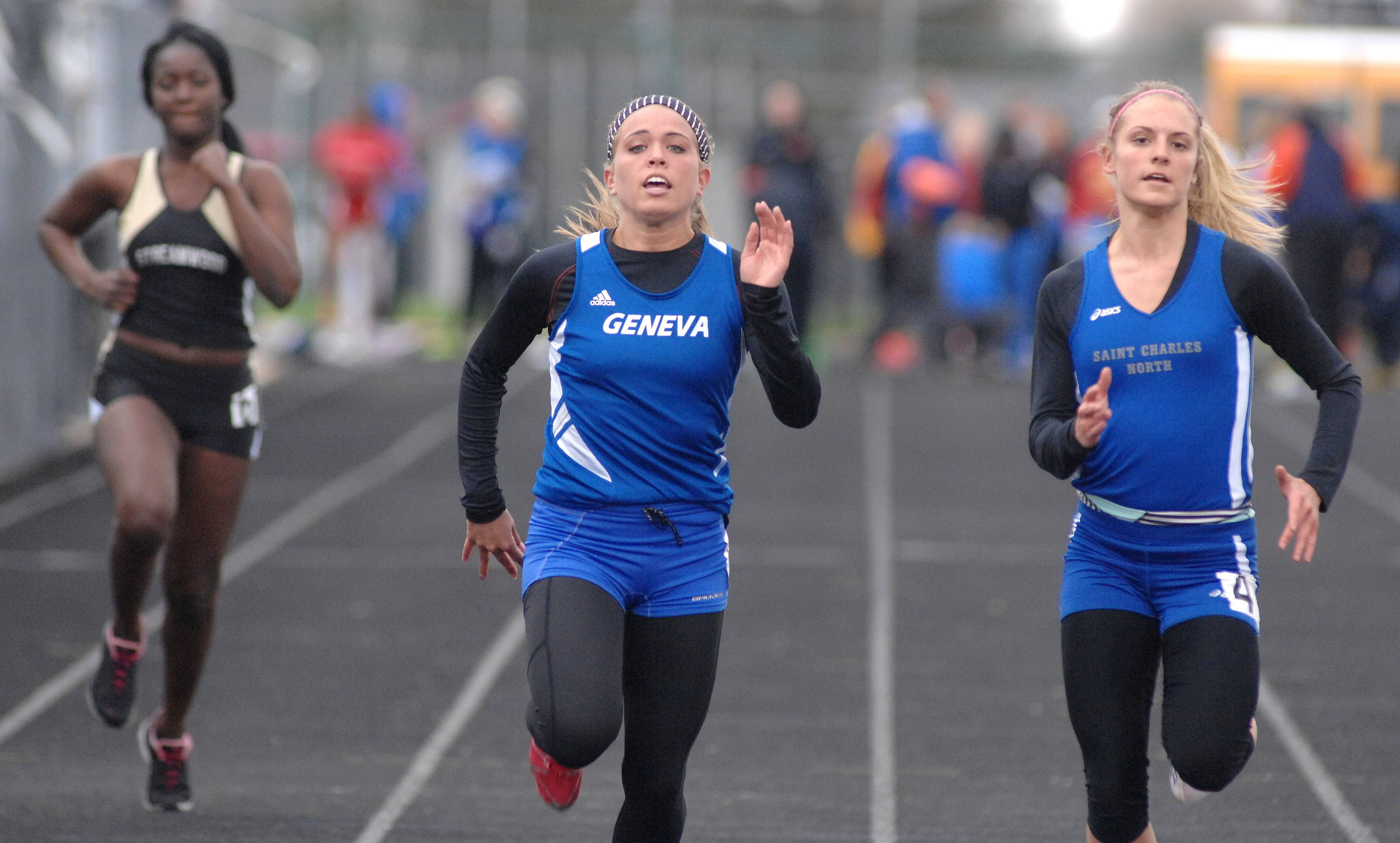 Geneva's Isabella Median, center, leads St. Charles North's Quinn Samanic, right, in the 100-yard prelims.