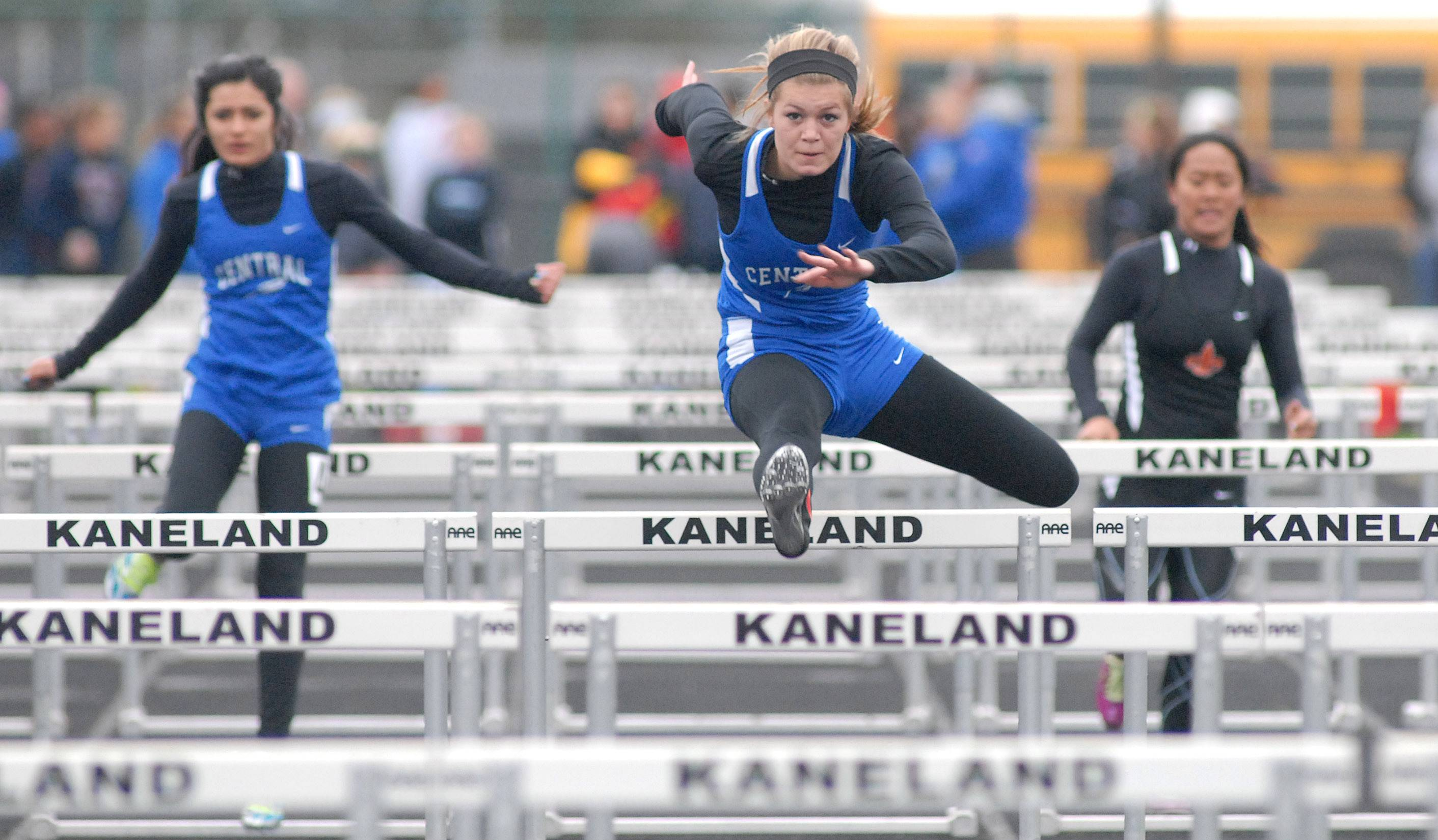 Burlington Central's Bryce Weinrich wins the first prelim of the 100-yard hurdles at Kaneland High School in Maple Park on Friday, May 2.