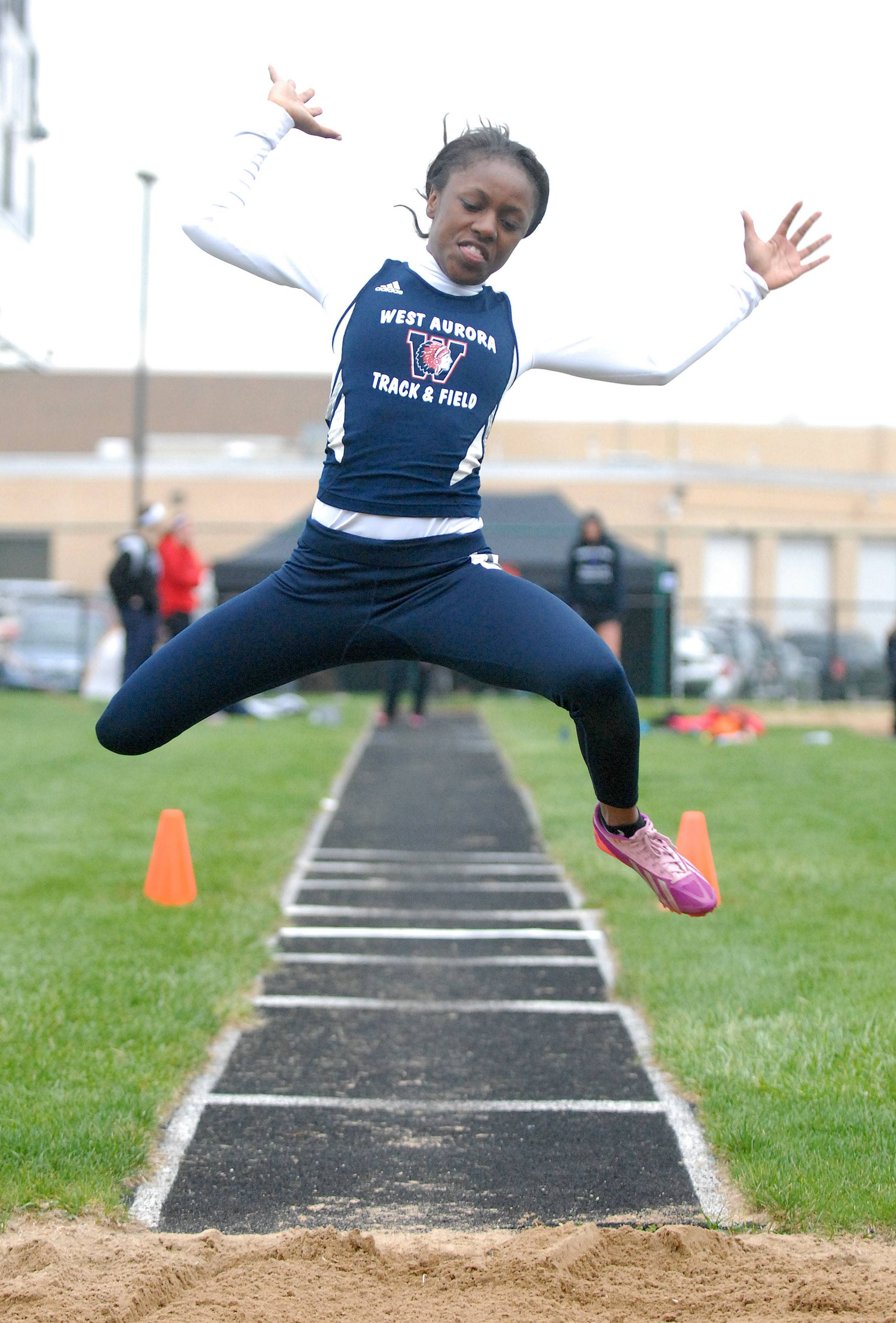West Aurora's Rajiah Andrews in the triple jump finals at Kaneland High School in Maple Park on Friday, May 2.