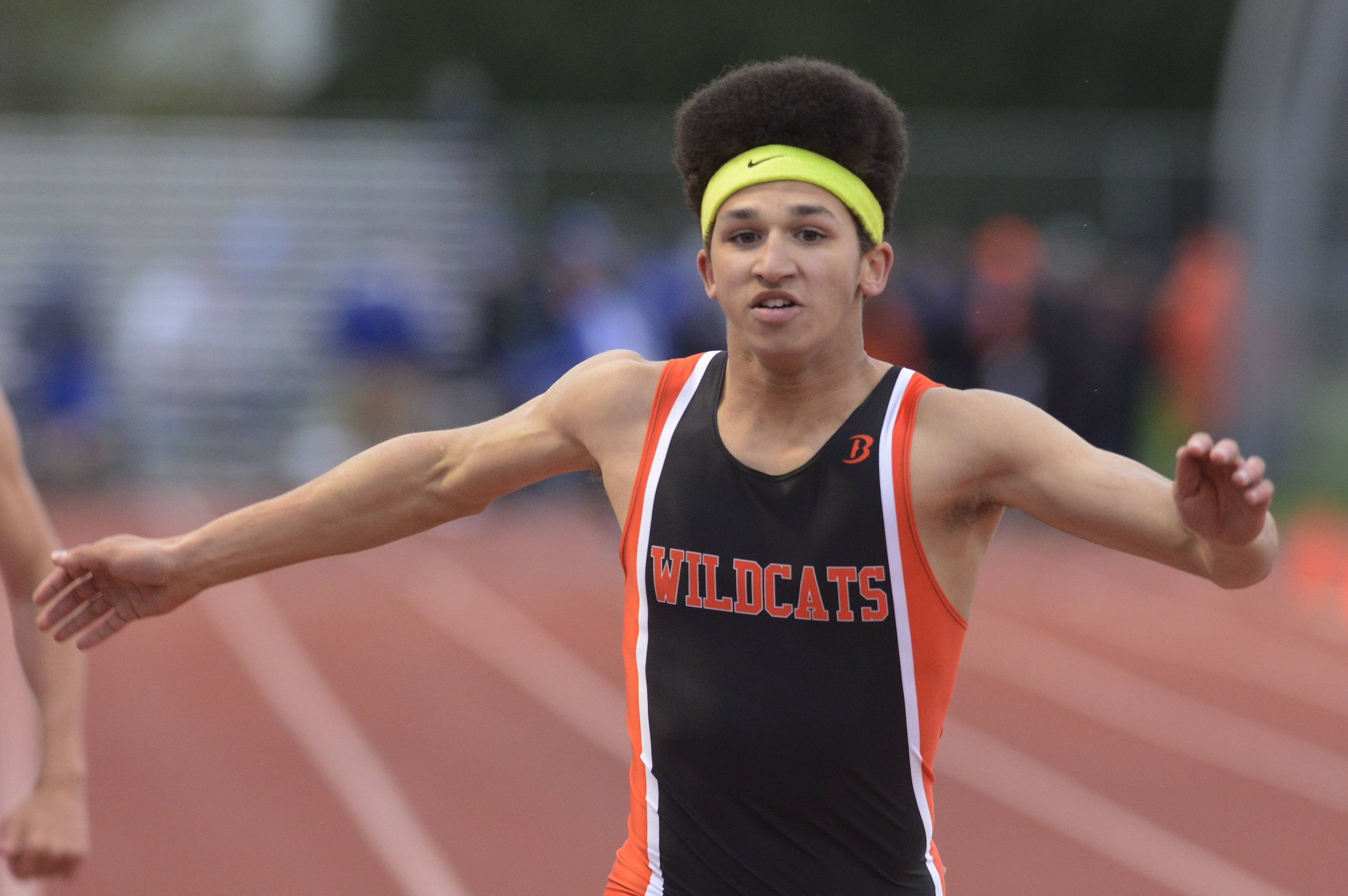 Keith Wilson of Libertyville crosses the finish line in the 200-meter dash prelims during the Wanner Invitational at Prospect on Friday.