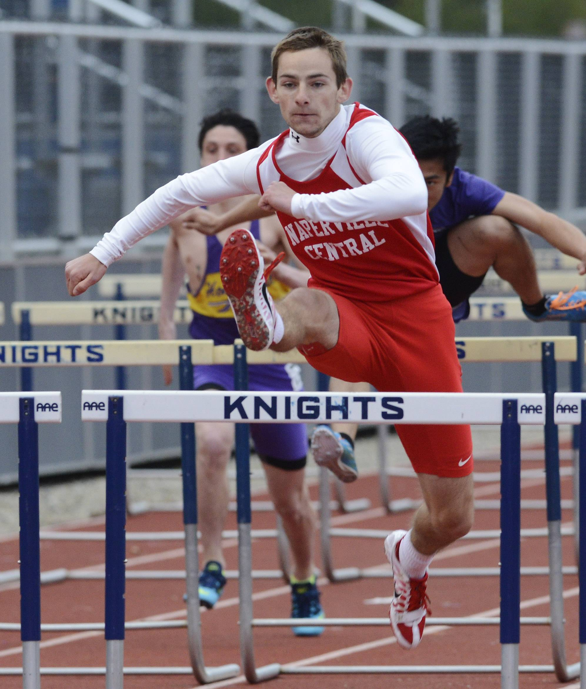 Michael Jopes of Naperville Central wins his heat of the 110-meter high hurdles during the Wanner Invitational at Prospect on Friday.