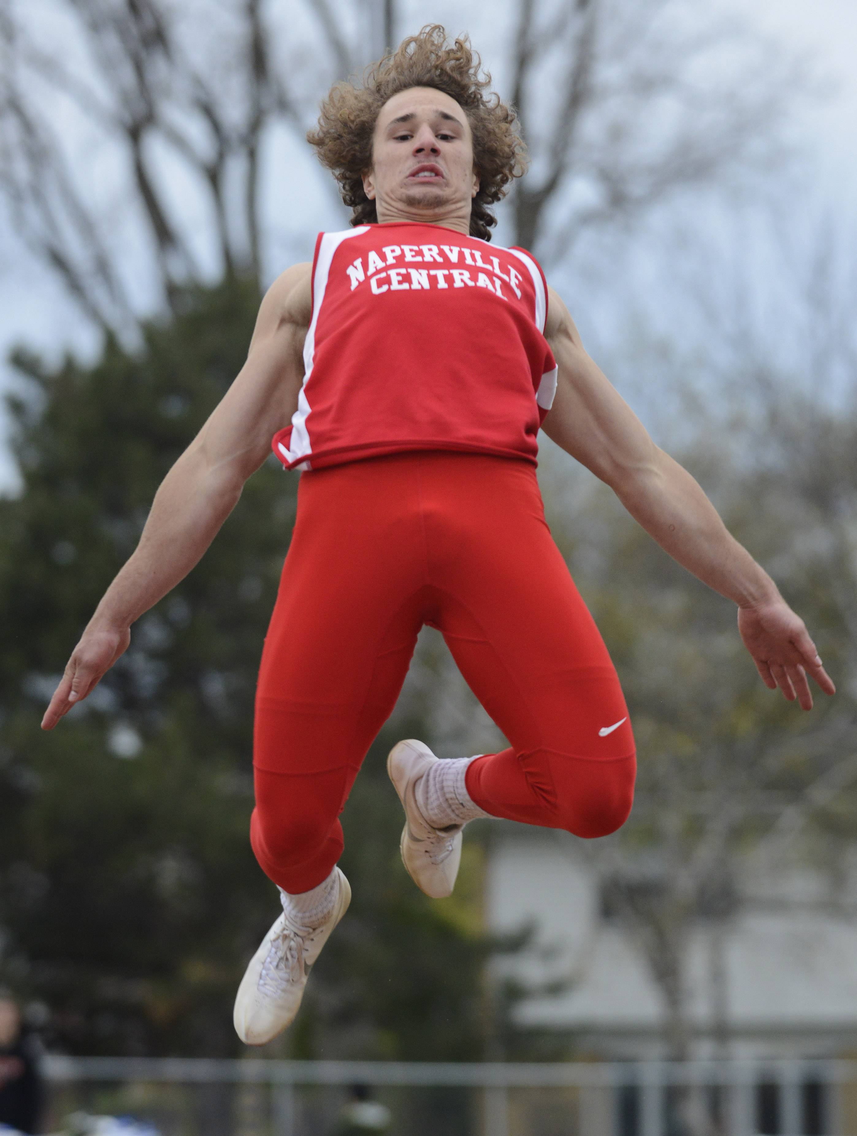 Naperville Central's Ben Andreas competes in the long jump during the Wanner Invitational at Prospect on Friday.