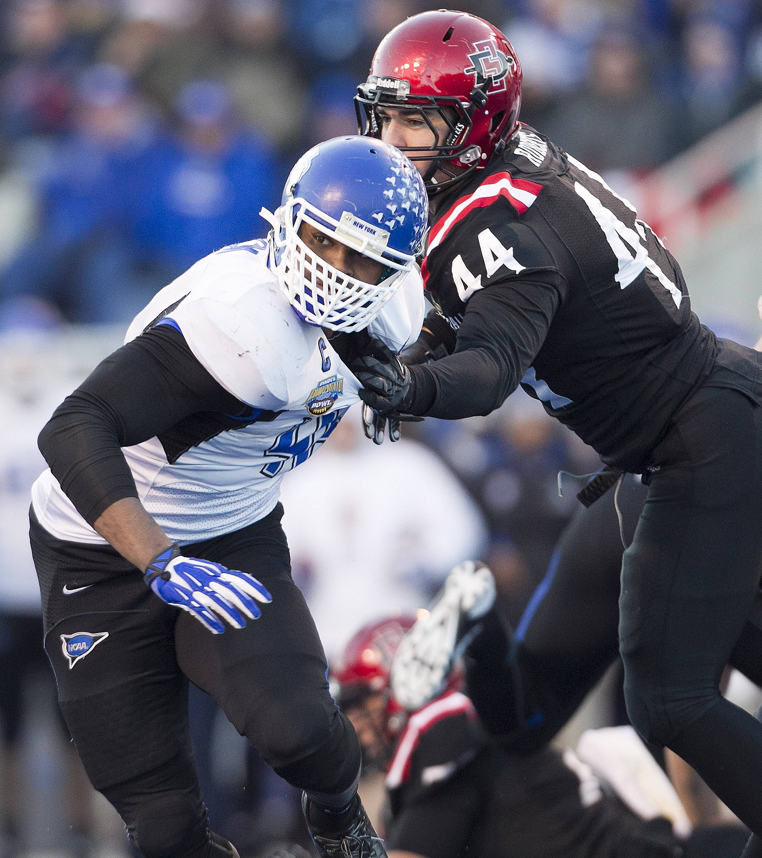 Khalil Mack (46) gets held by San Diego State tight end Adam Roberts during the Famous Idaho Potato Bowl. Mack has gone from a mostly overlooked college recruit to a top 10 NFL draft prospect.