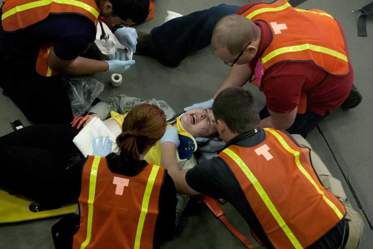 Caption: Jaime Lemens, Nursing Lab Technician at College of DuPage, plays the role of a gunshot victim during a recent simulation that involved six health care programs. (Photo by Press Photography Network/Special to College of DuPage)