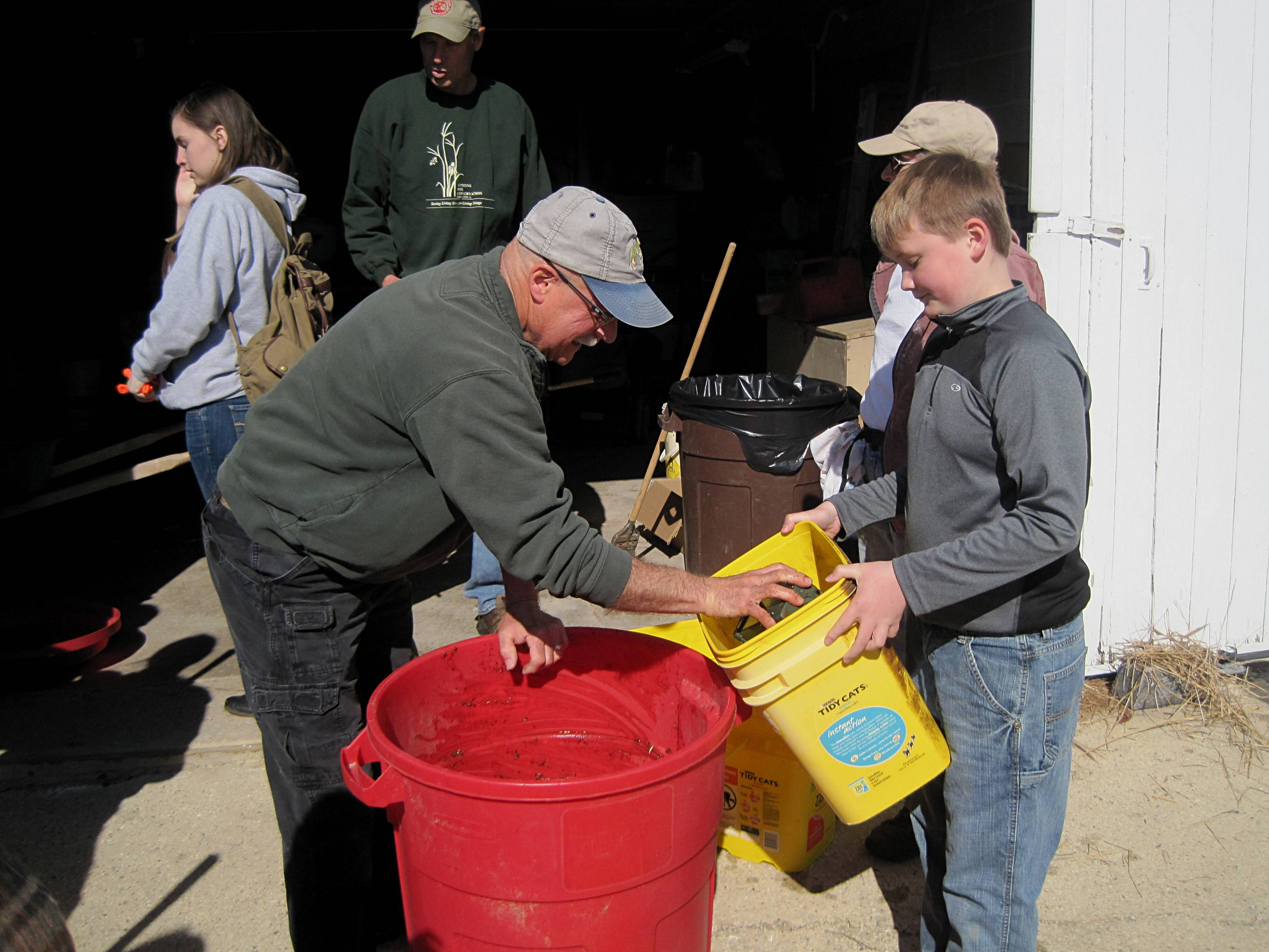 A grandfather/grandson team prepares the seed supply for their workday on the prairie.