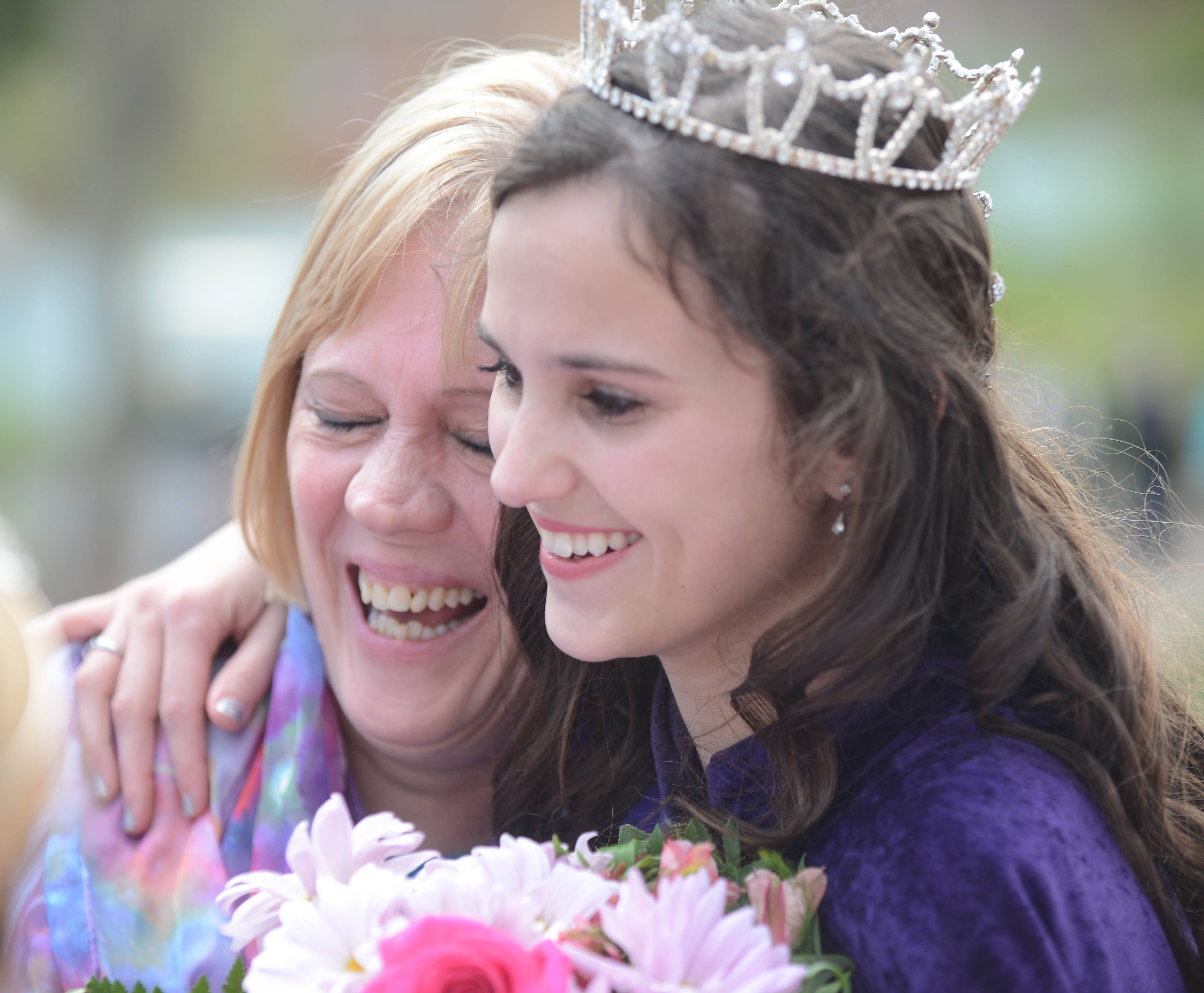 Newly crowned Lilac Queen Kendall Kott hugs Terri Soehrmann, the co-chair of the Lilac Queen coronation after Saturday's ceremony.
