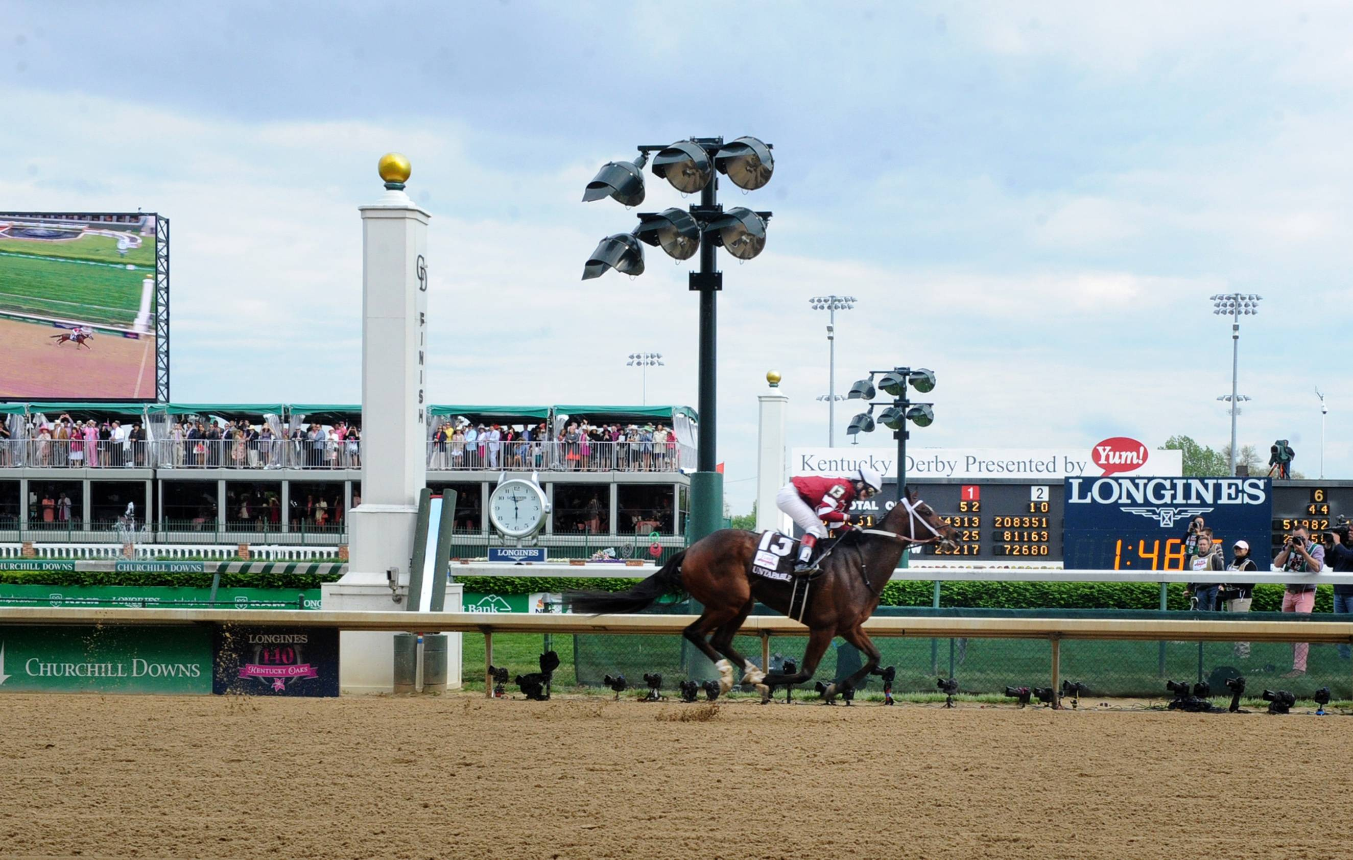 Untapable, ridden by Rosie Napravnik, wins the Longines Kentucky Oaks on Kentucky Oaks Day, Friday, May 2, 2014, in Louisville, Ky.  Longines, the Swiss watch manufacturer known for its luxury timepieces, is the Official Watch and Timekeeper of the 140th annual Kentucky Derby.