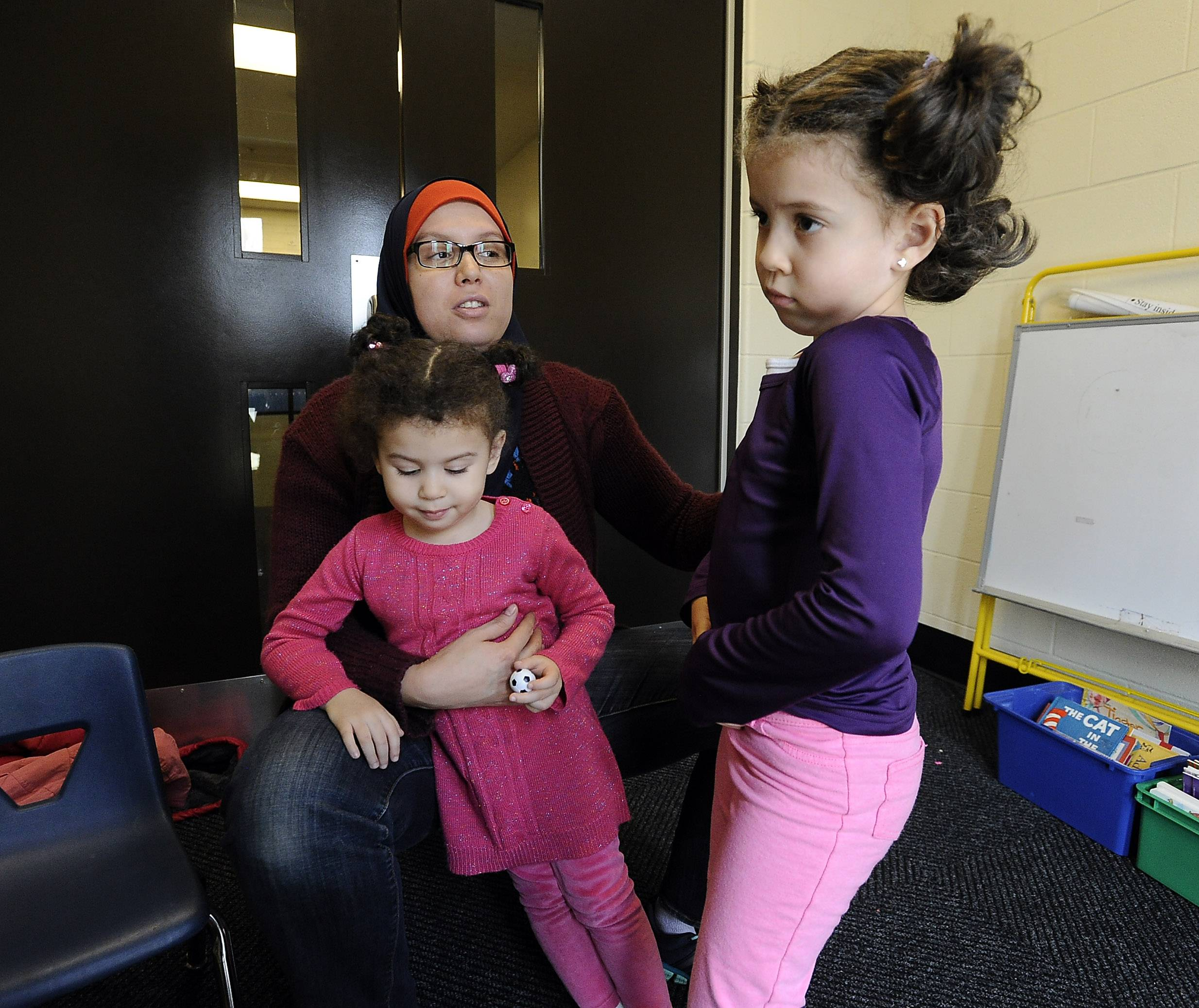 "Housna Ghazoualine, with her daughters Farah Hakimi, 3, and Zaynab, 5, said Schaumburg Township Elementary District 54's early childhood program has been invaluable to her and her family. ""They teach (the students) how to be independent. They teach them how to be responsible,"" she said."