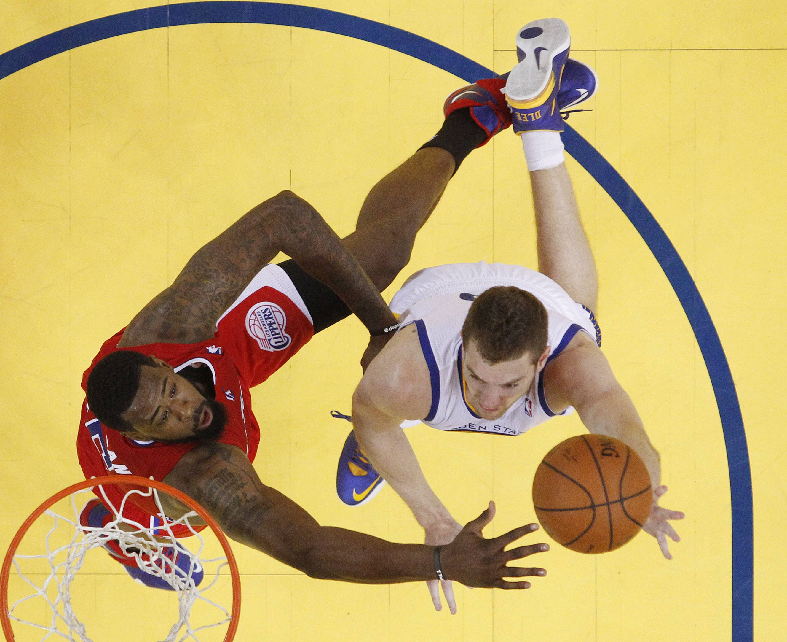 Golden State Warriors' David Lee, right, shoots next to Los Angeles Clippers' DeAndre Jordan during the second half in Game 6 of an opening-round NBA basketball playoff series on Thursday, May 1, 2014, in Oakland, Calif. Golden State won 100-99. (AP Photo/Marcio Jose Sanchez)