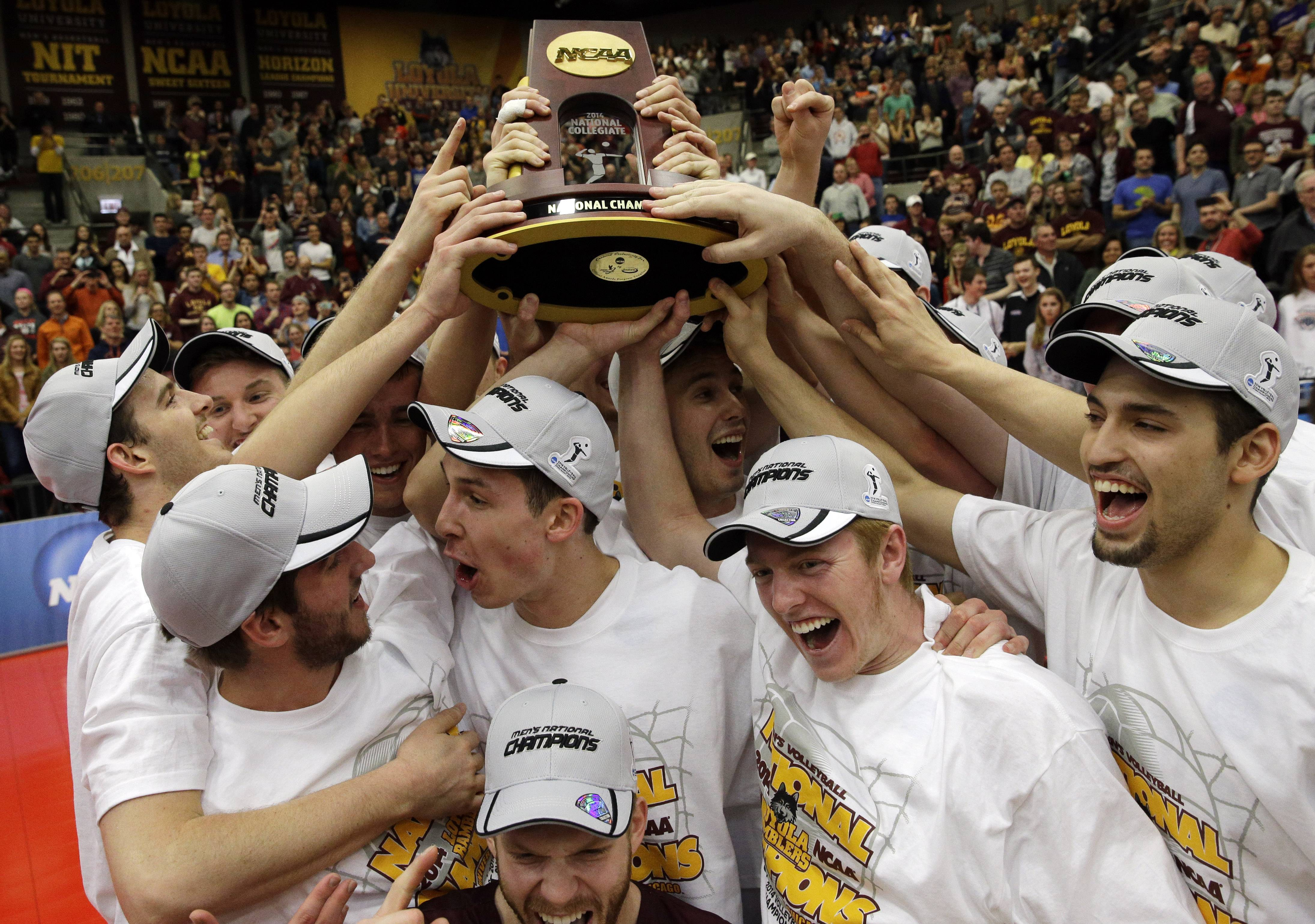 Loyola players celebrate as they hold the championship trophy after defeating Stanford 3-1 in the NCAA men's college volleyball championship at Gentile Arena in Chicago on Saturday, May 3, 2014.