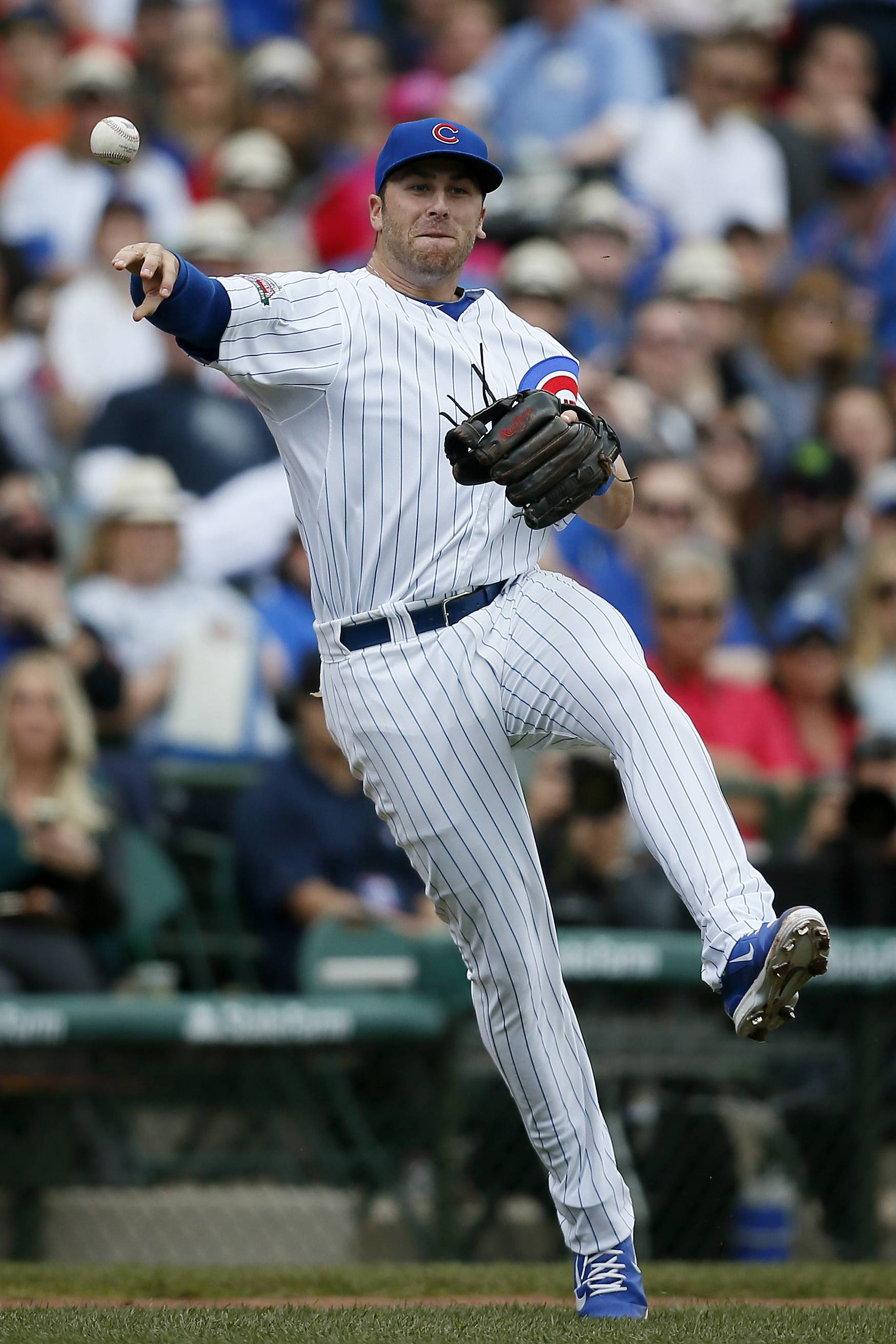 Cubs third baseman Mike Olt throws to first for an out against the St. Louis Cardinals' Allen Craig during the fifth inning of a baseball game on Saturday, May 3, 2014, in Chicago. (AP Photo/Andrew A. Nelles)