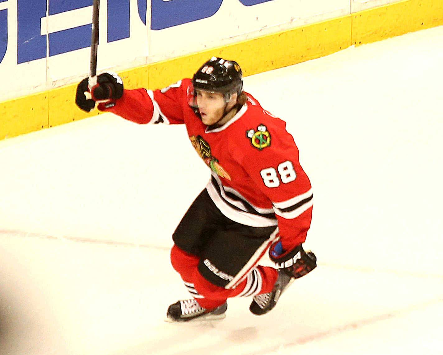 Patrick Kane celebrates his awe-inspiring goal on a backhand to break a 2-2 third-period goal in Game 1 Friday night.
