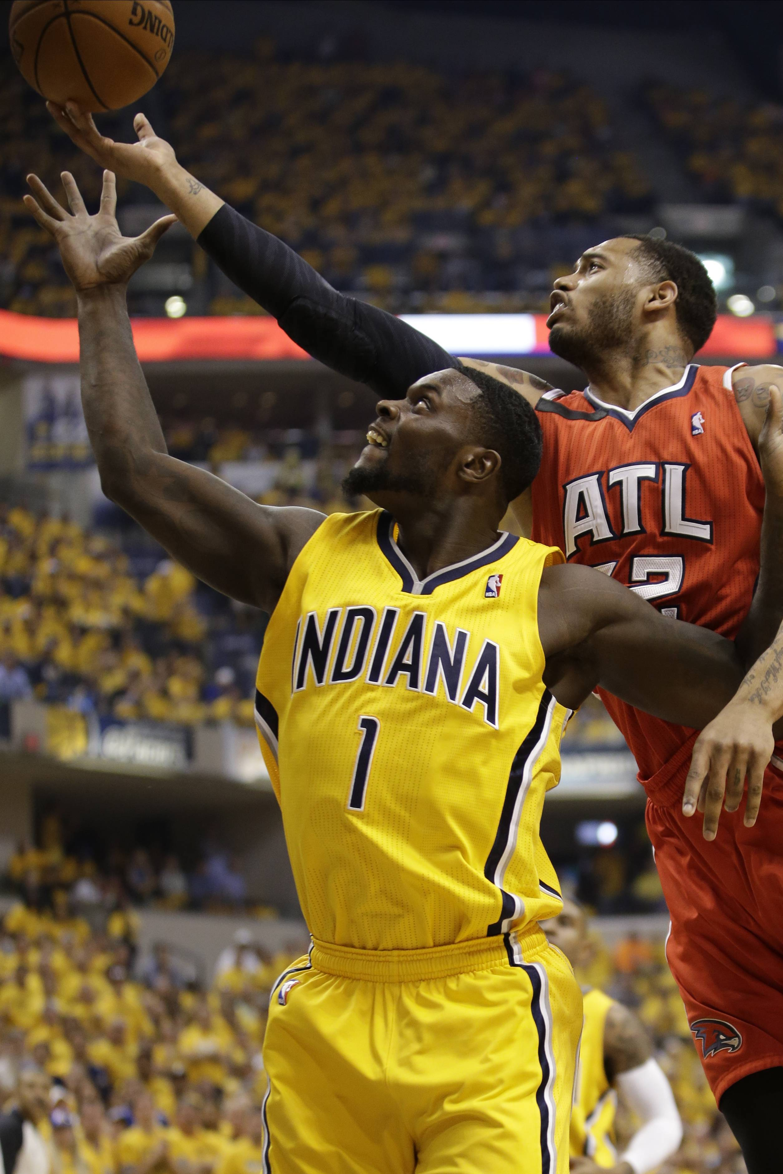 Atlanta Hawks forward Mike Scott (32) shoots over Indiana Pacers guard Lance Stephenson (1) during Game 7 of a first-round NBA basketball playoff series between the Indiana Pacers and the Atlanta Hawks Saturday in Indianapolis. The Pacers won 92-80.