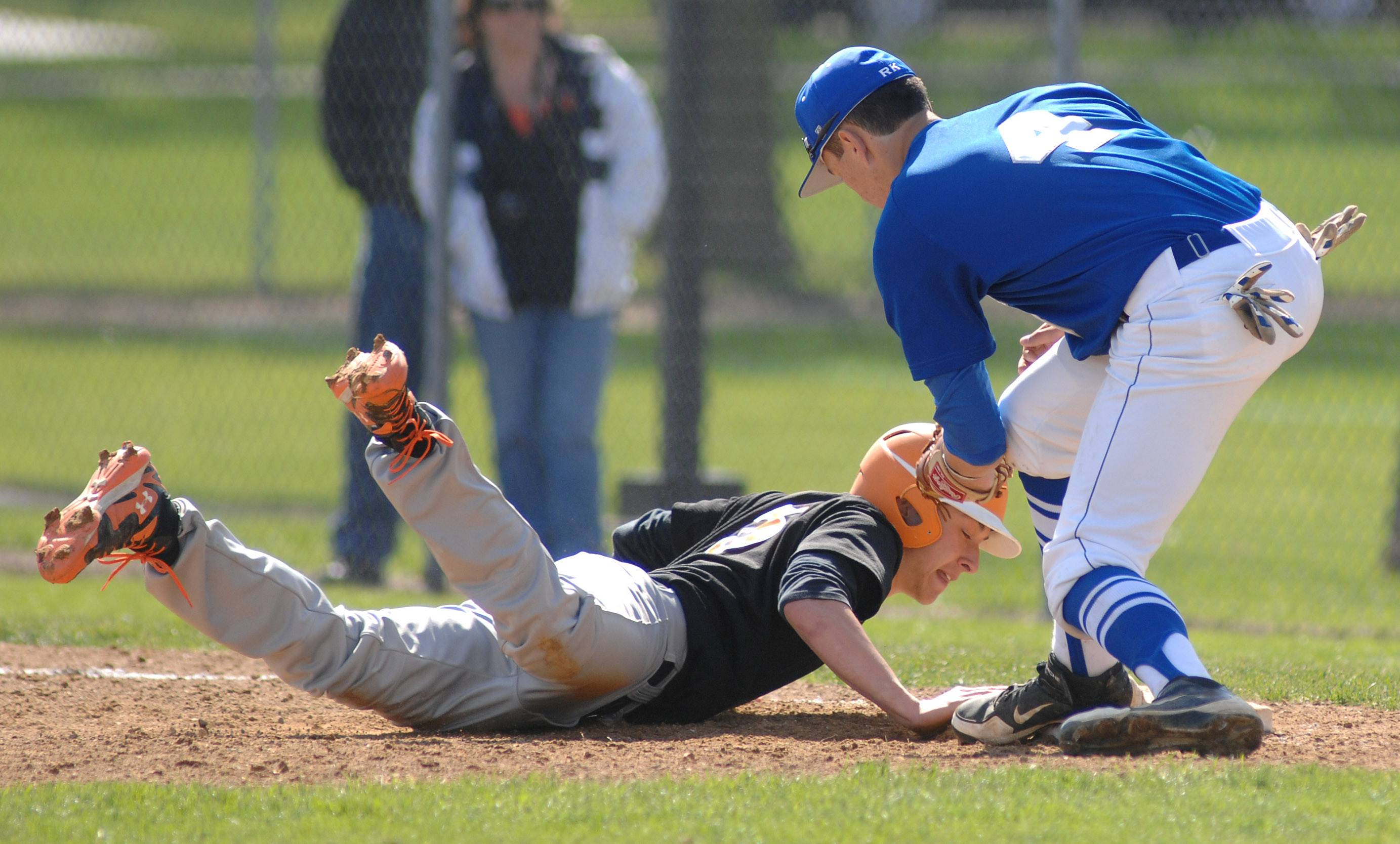 St. Charles East's Austin Regelbrugge is safe back on first base from Geneva's Nick Porretto in the fifth inning on Saturday, May 3.