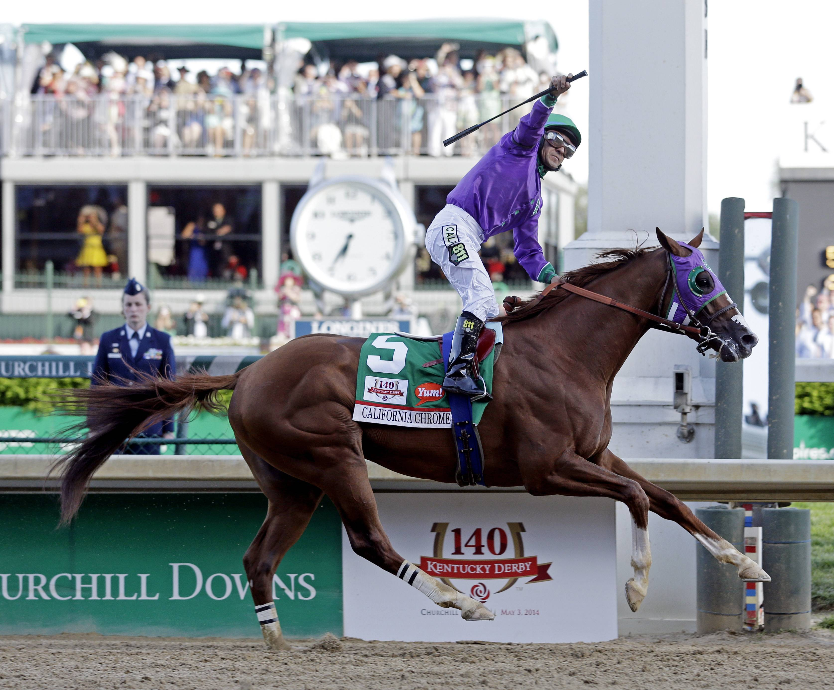 Victor Espinoza rides California Chrome to a victory during the 140th running of the Kentucky Derby horse race Saturday at Churchill Downs in Louisville, Ky.
