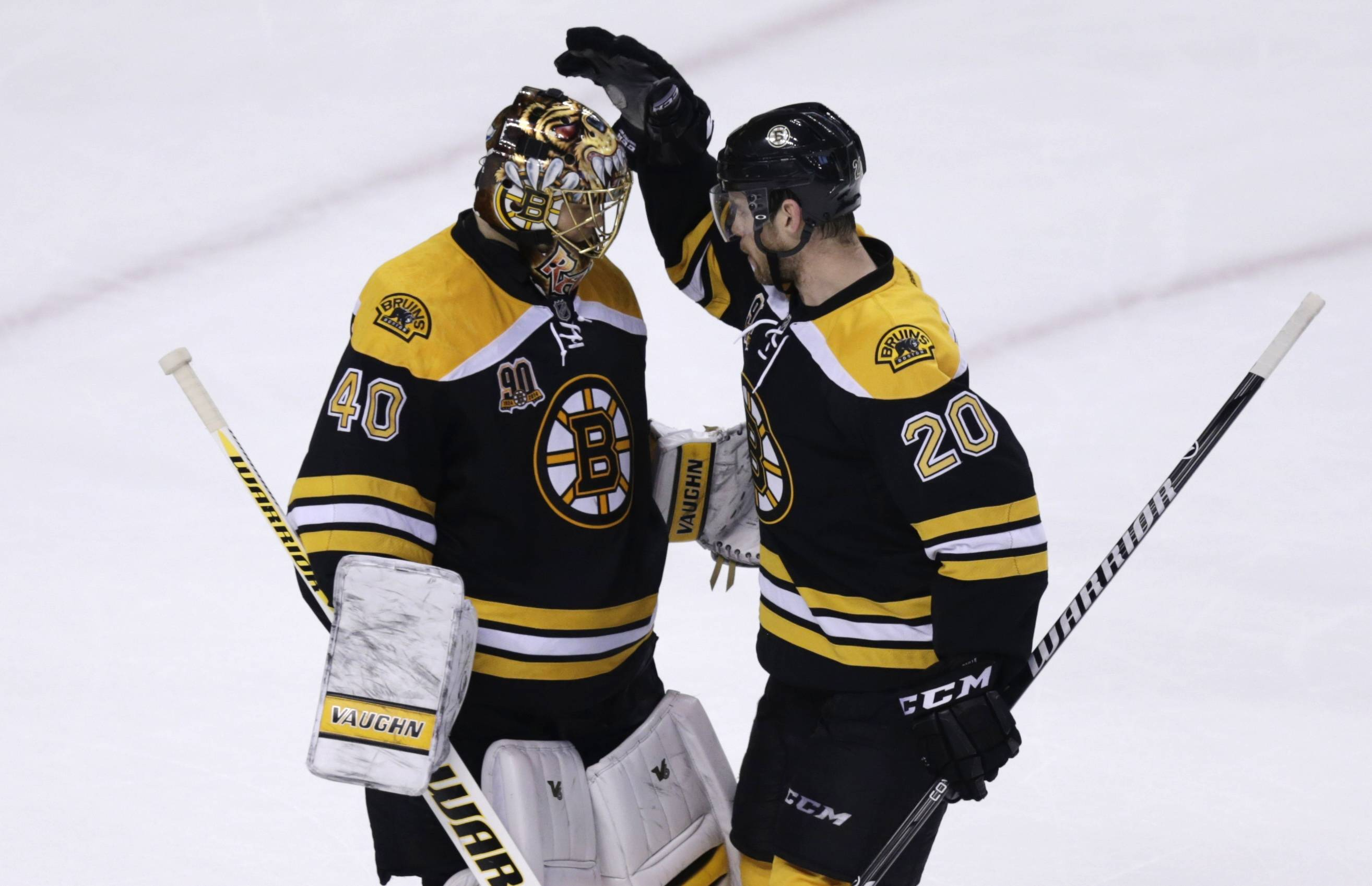 Boston Bruins goalie Tuukka Rask (40) is congratulated by teammate Daniel Paille (20) after defeating the Montreal Canadiens in Game 2 in the second-round of the Stanley Cup hockey playoff series in Boston, Saturday, May 3, 2014. The Bruins defeated the Canadiens 5-3, tying the series at one game each. (AP Photo/Charles Krupa)