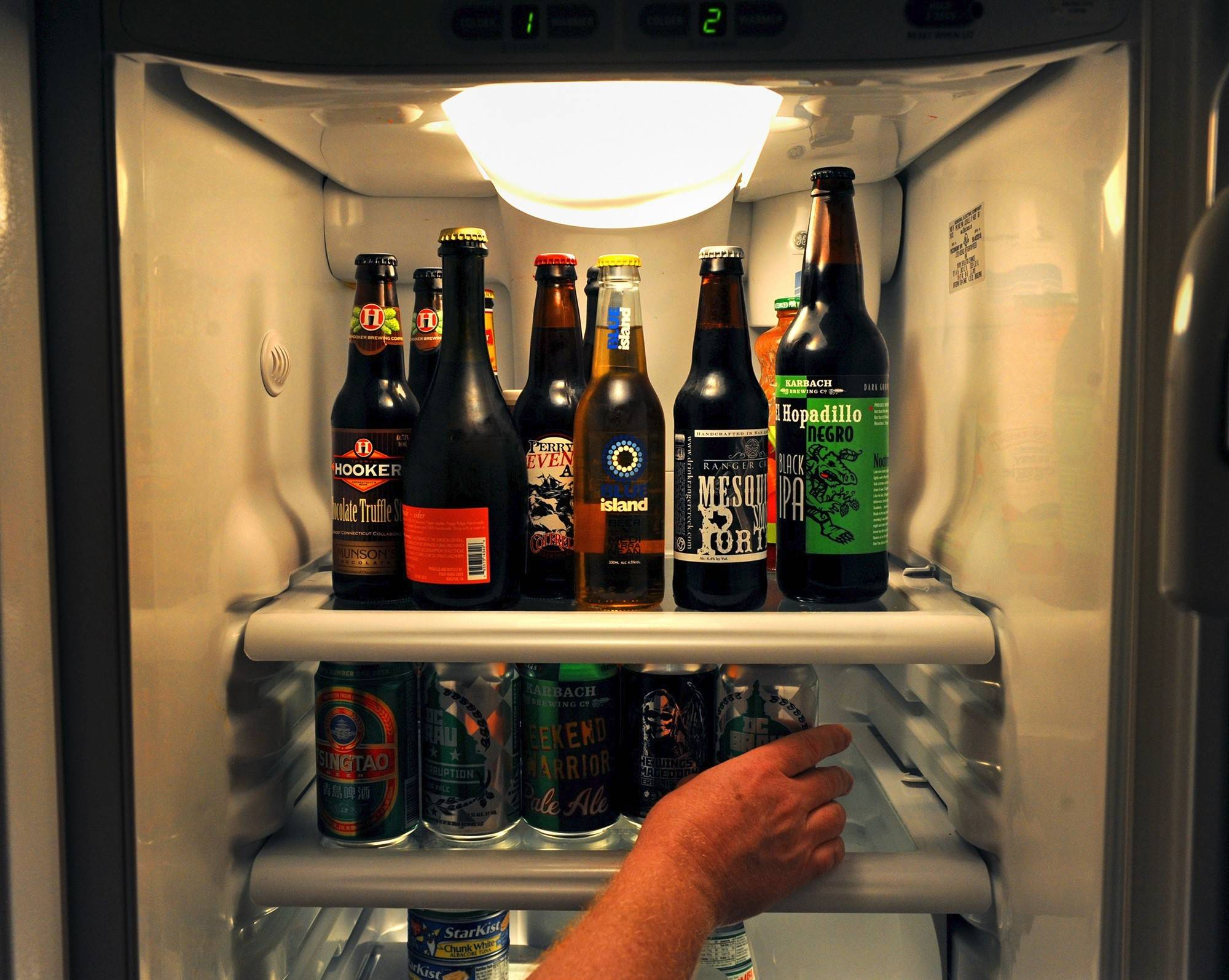 Gene Bonventre stores scores of beers in a refrigerator in his Washington home.