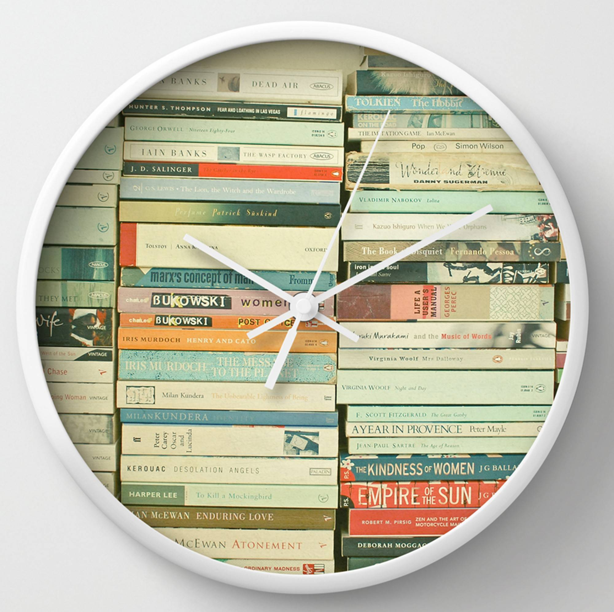 "A clock with Cassia Beck's ""Bookworm"" ($30), available at Society6. The website is always looking for new ""ways to display art in home decor."