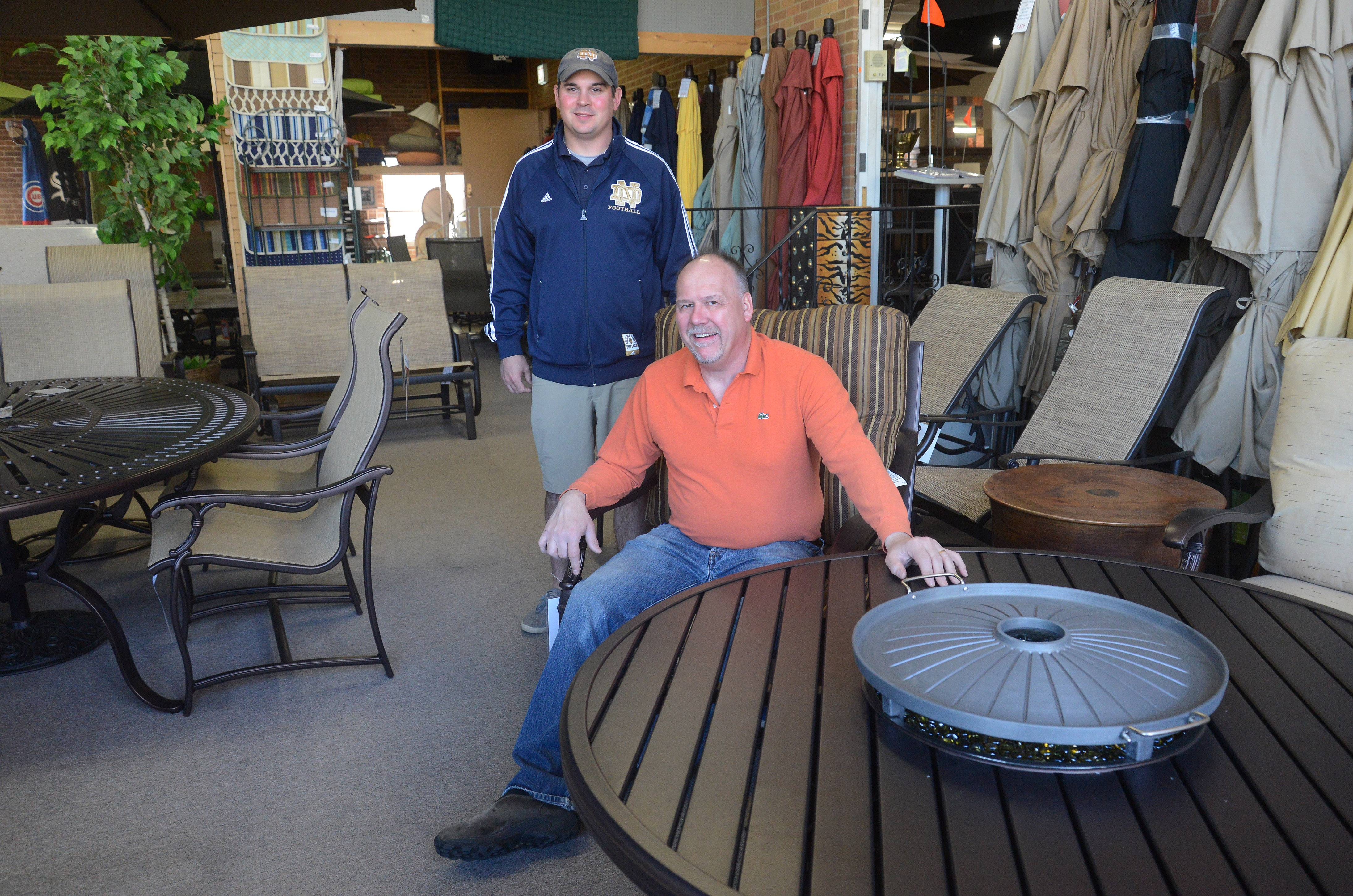 Northwest Metalcraft owner Dan Mayer, foreground, and his nephew Zac Selleck sell and install fireplaces, fire pits and outdoor furniture at the Arlington Heights business.